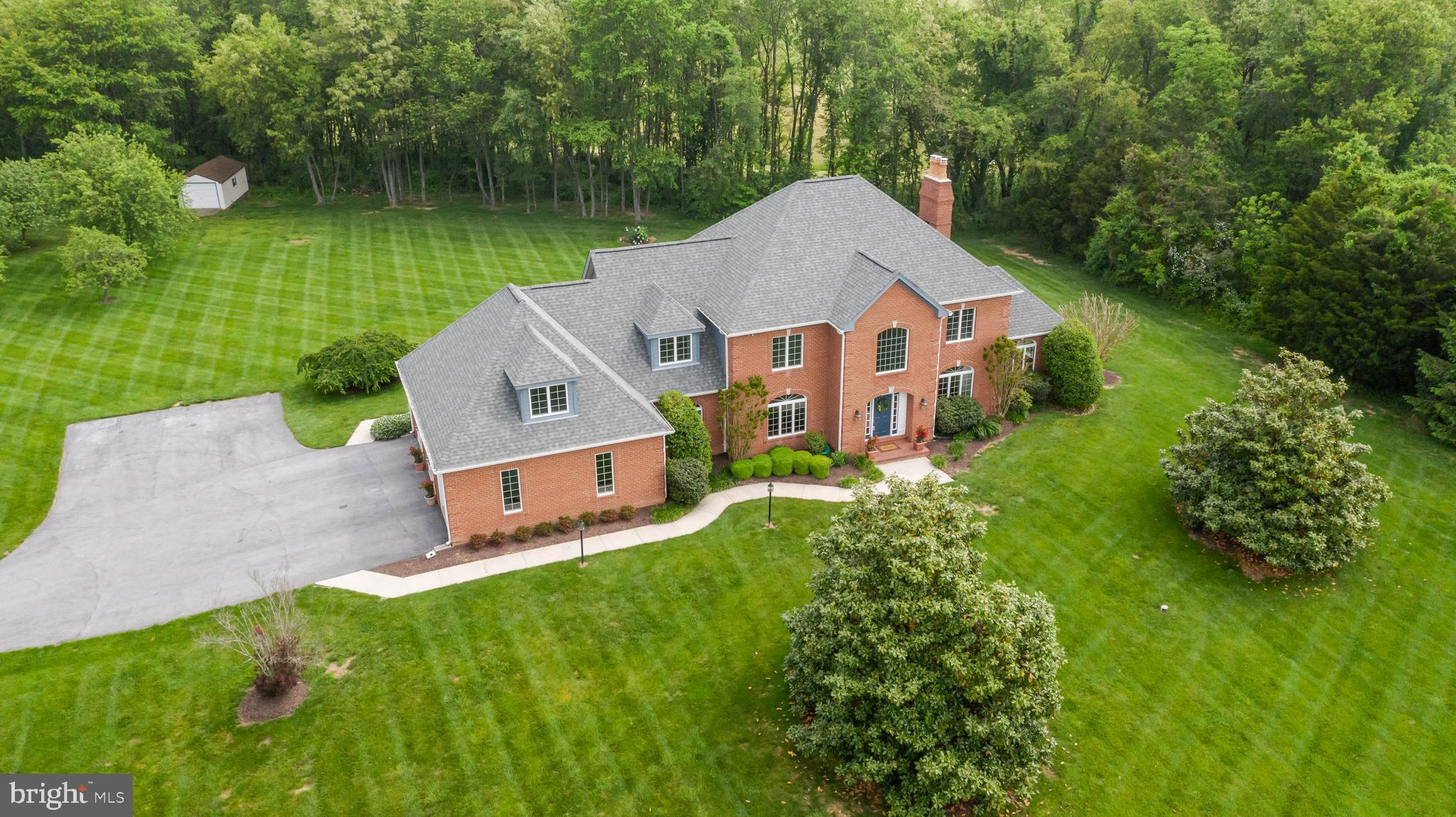 Custom-built colonial nestled on a corner lot set on a quiet, private street!~ Beautiful exteriors a