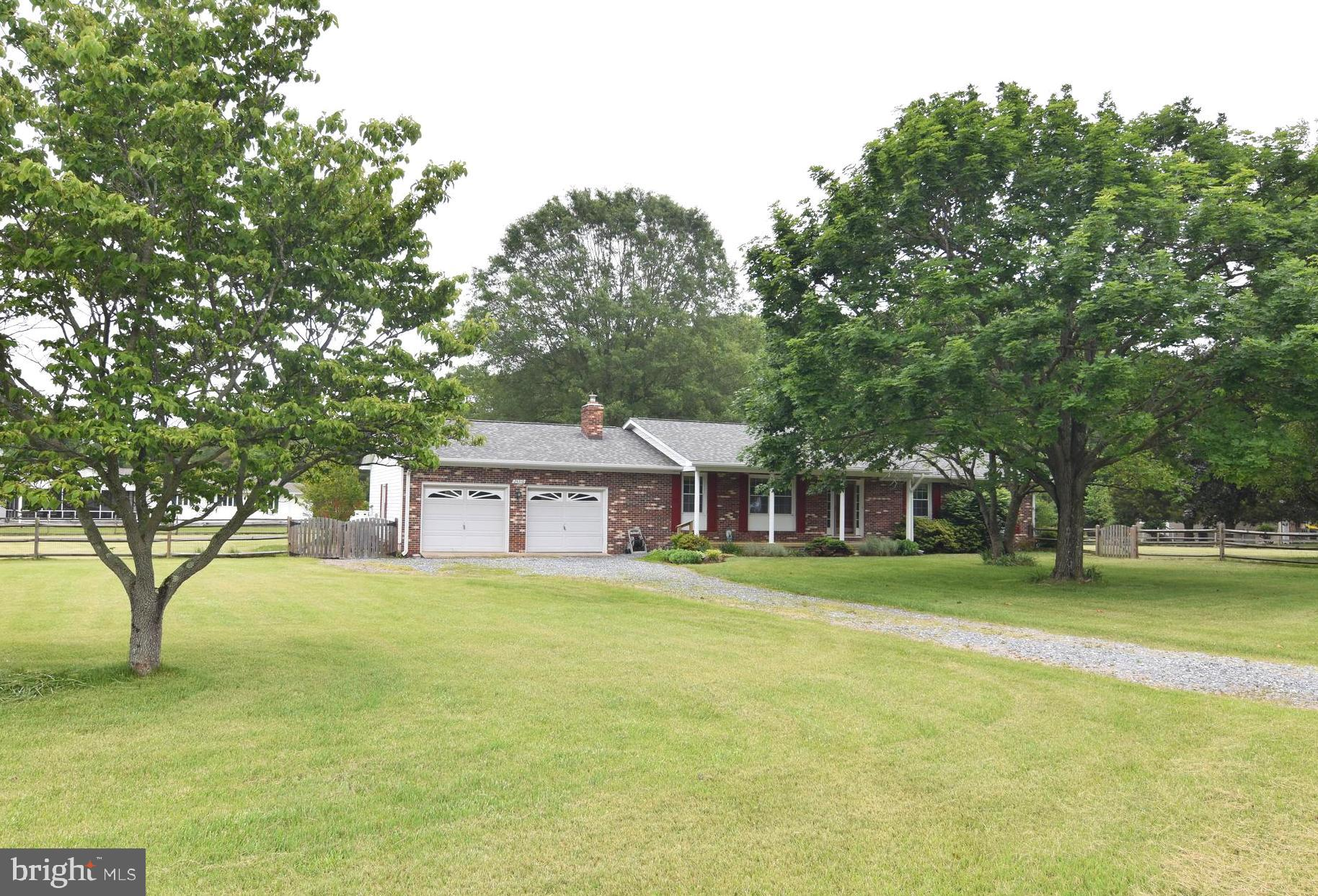 Well cared for rambler on beautiful lot.  Open floor plan, hardwood floors, updated kitchen with gra