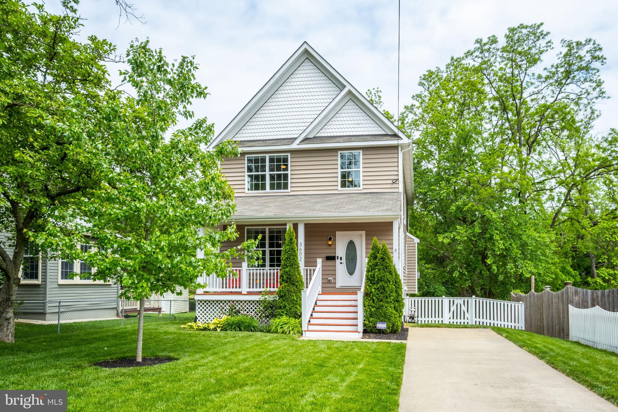 Beautiful 4BR/3.5BA three-level craftsman style home situated on a meticulously landscaped lot in so