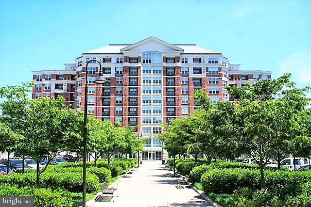 BEAUTIFUL CONDO ON THE 9TH FLOOR AT THE MERCER!! One of Reston's Most Well Maintained Condominiums with all the Right Amenities; Lobby with Concierge, Club Room with Dining Room, Bar and Lounge Area. Media Work Stations, Fitness Room, Picnic/BBQ Area and Pool with Lounge Chairs. One Bedroom and One Bath Condo with BRAND NEW Hardwood Laminate Floors. Entry with Ceramic Tiled Floors and Coat Closet. Kitchen with Granite Counters, Breakfast Bar and Stainless Steel Appliances (French Door Refrigerator with Freezer Drawer, NEW 2018). Living Room with Halogen Light Fixture, Dining Area and Access to Balcony with Panoramic Views of Reston. Master Bedroom with Walk-In Closet, Linen Closet and Access to Dual Entry Master Bath with Sink Vanity, Tiled Floors,  Linen Closet, Soaking Tub and Shower. Laundry with Stacked Washer and Dryer. ***Underground Garage Parking Spot and Seller-Paid One Year Home Warranty Conveys to New Owner*** Easy Access to Wiehle-Reston Metro Station, Reston Town Center with Shopping and Restaurants and all Major Roads***
