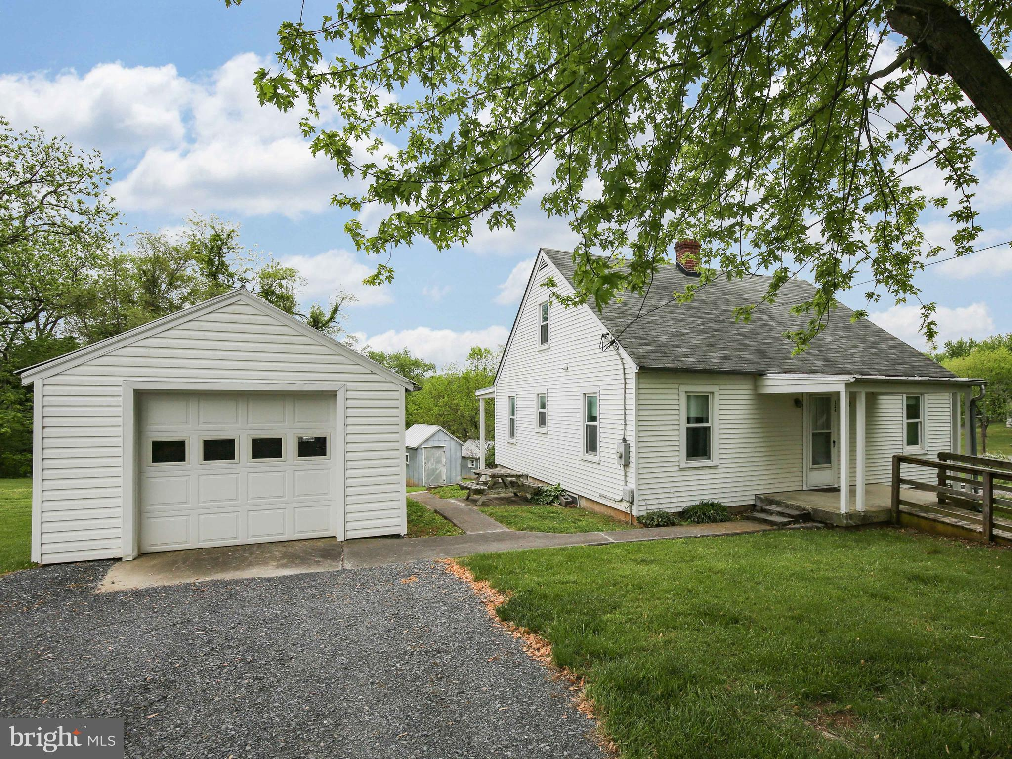 Affordable Cape style cottage home on an acre just right outside of the city off Rt. 50 W.  Detached
