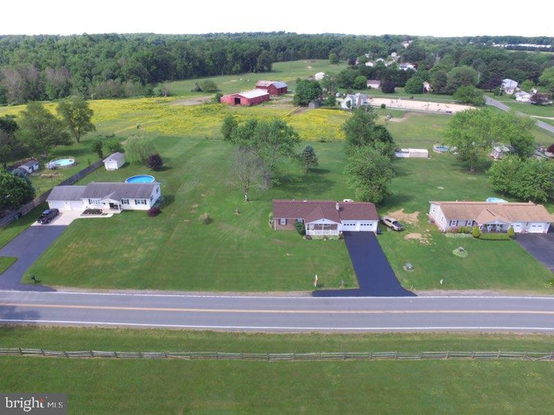 Affordable, Beautiful country acre setting, features ranch style house with 2 car attached garage ju
