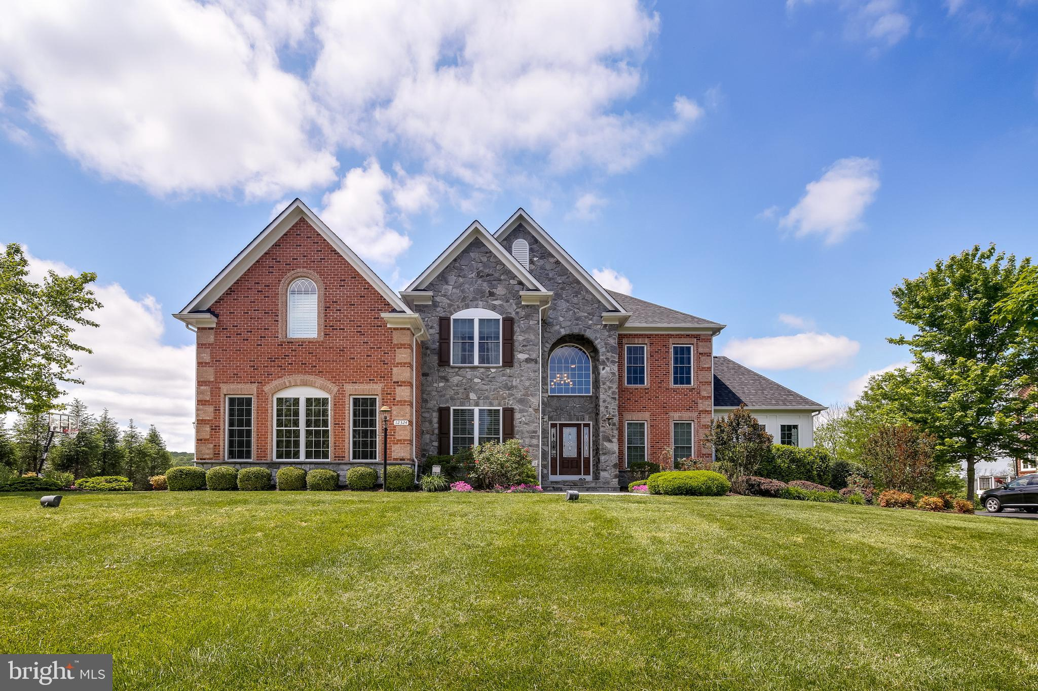 Fall in love with this absolutely spectacular former model home! This one-of-a-kind beauty begins wi