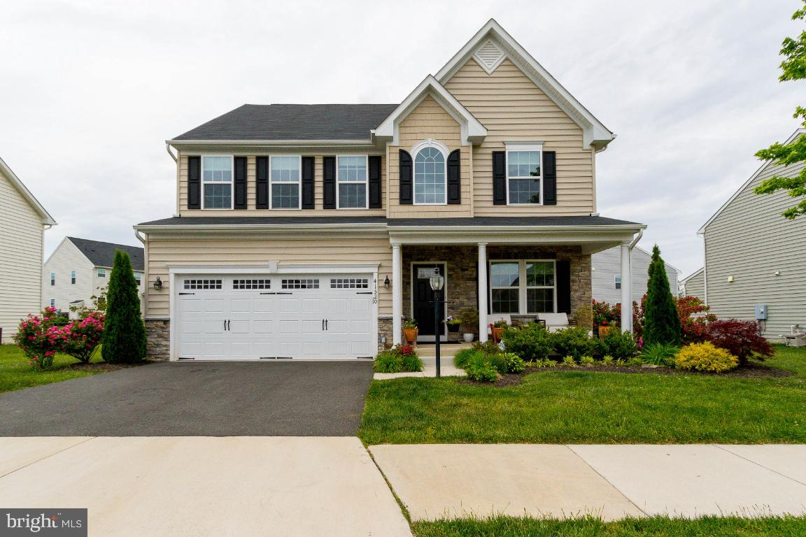 Stunning modern well cared for and gently lived in home, in highly desired Loudoun County Crossings,