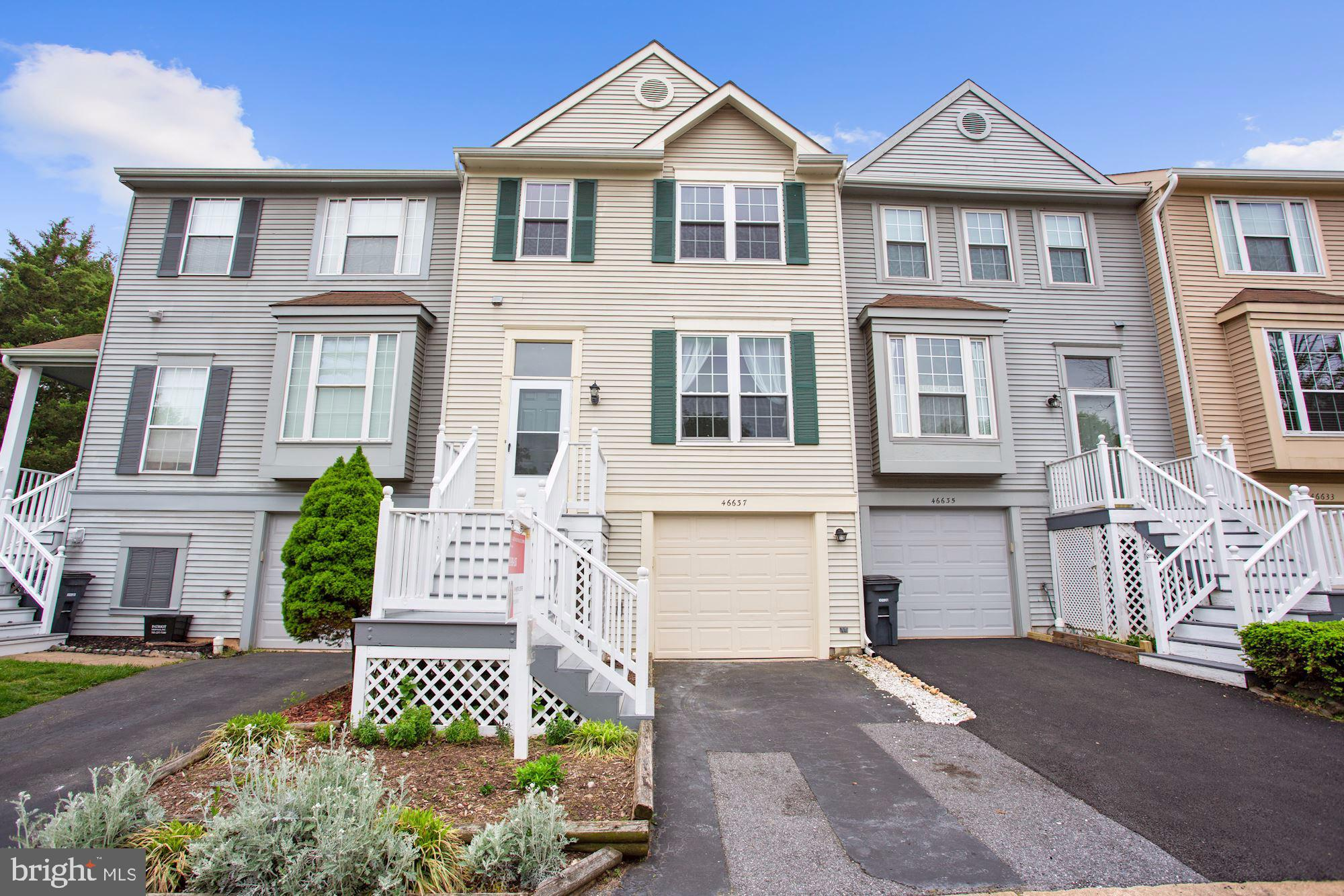 Welcome home! Spacious 3 bedroom, 2.5 bathroom townhome boasts gleaming hardwood flooring and open-c