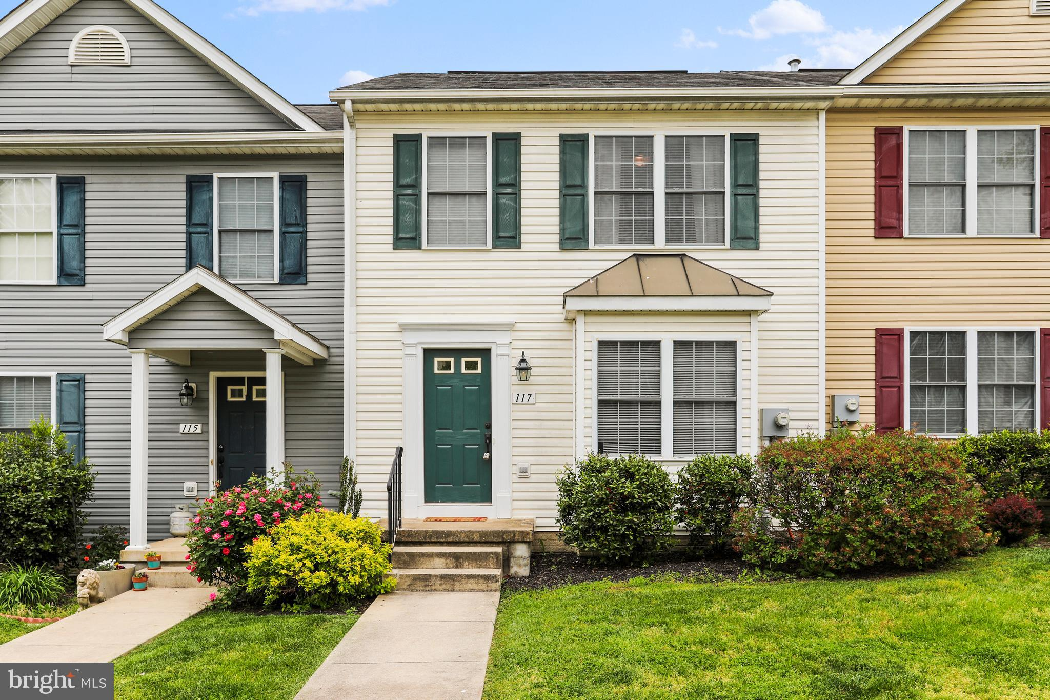 Upscale 3 Level Townhome features 3 bedrooms, 1.5 baths, living room, kitchen, dining area, rear dec