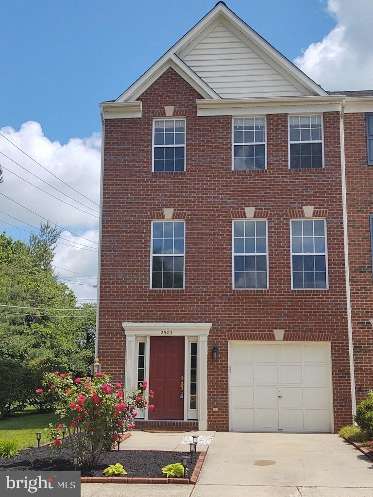 MUST SEE TO APPRECIATE - A gorgeous end unit brick front, 3 bedroom, 2 full and  2 half bath, 1 car