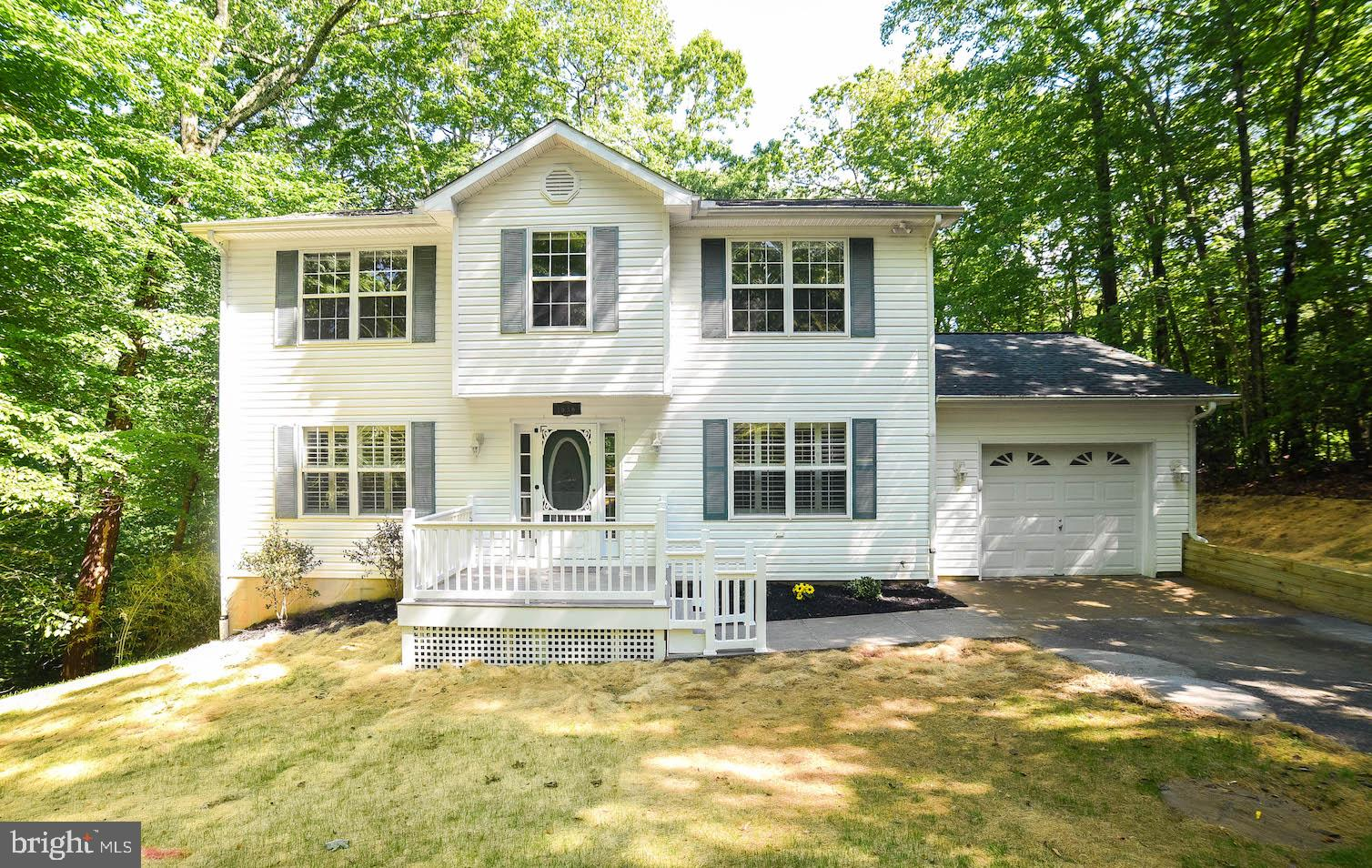 Move In Ready! This 4 bedroom 2 1/2 bath home has been freshly painted, new appliances and hardwood