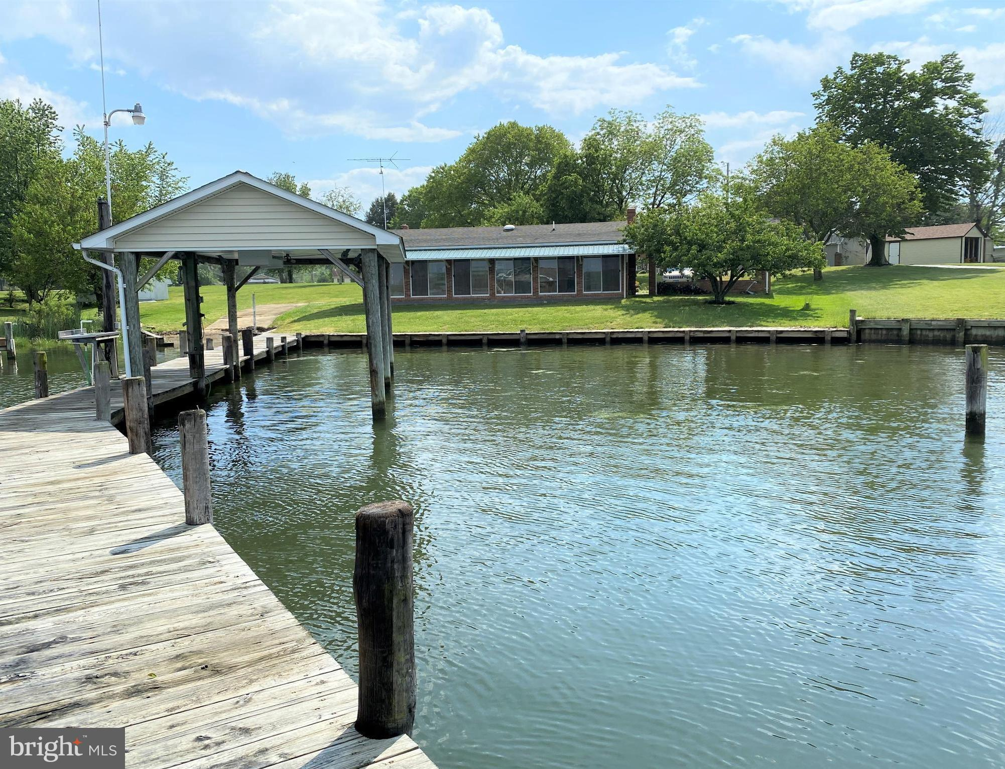 YOUR OWN PRIVATE BOAT RAMP on deep protected water comes with this spectacular waterfront property o