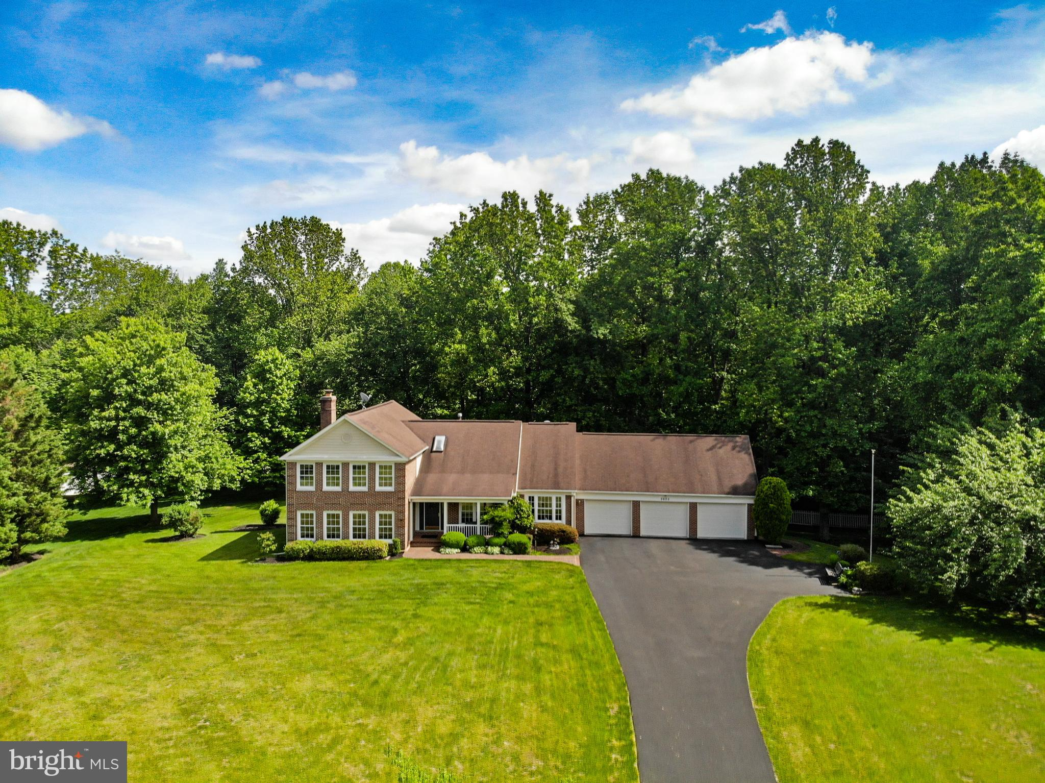 Elegant brick split level with open floor plan, in a quiet cul-de-sac close to GMU and Robinson HS.
