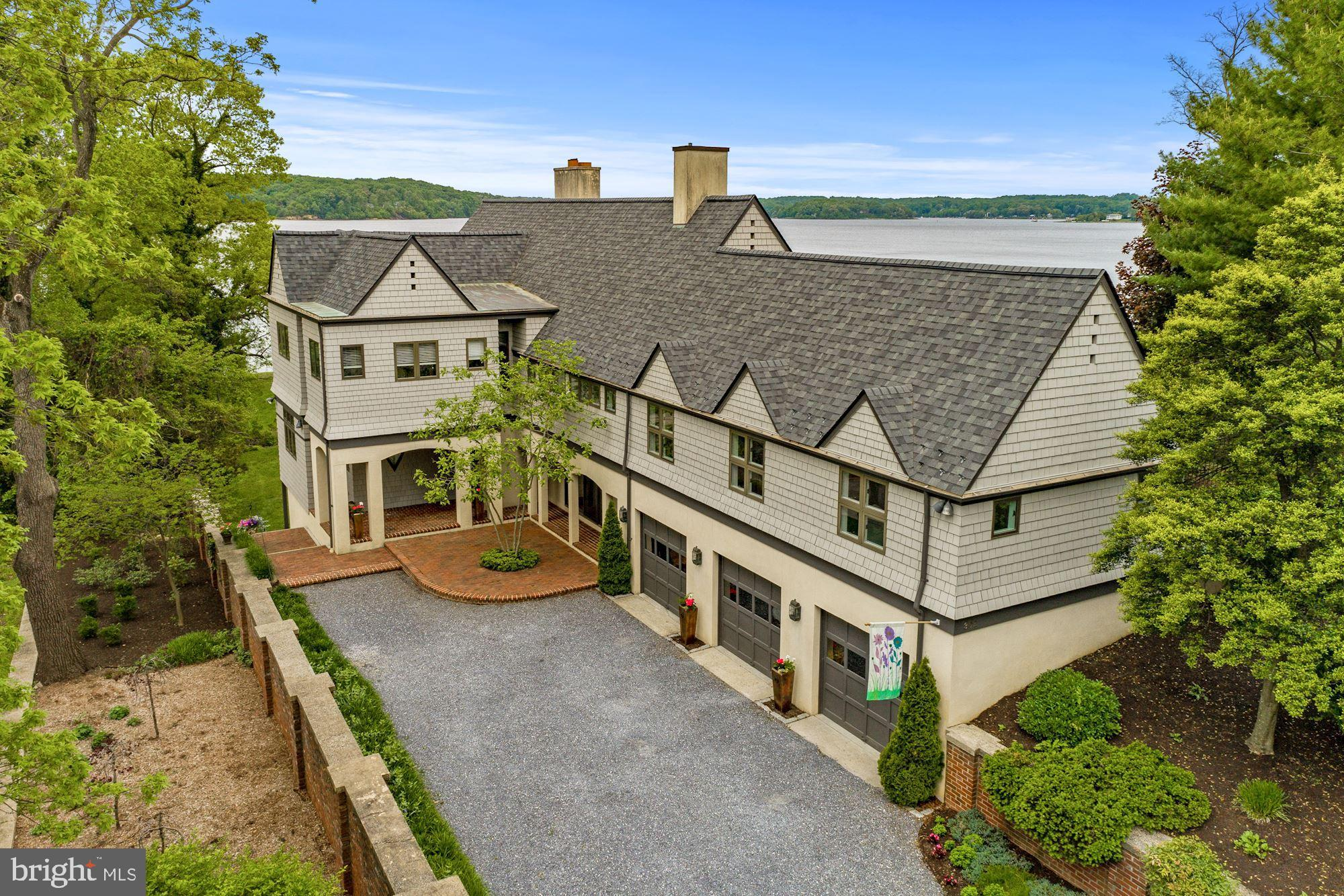 This is the first time this exceptionally built custom waterfront home in the prestigious community