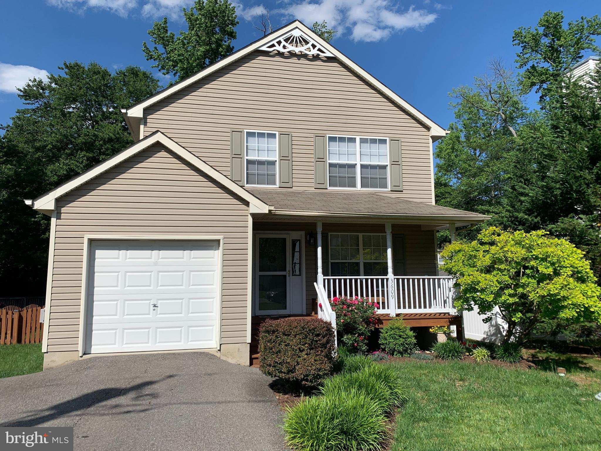 You'll love to call this home!  From the inviting front porch to the spacious deck overlooking the f