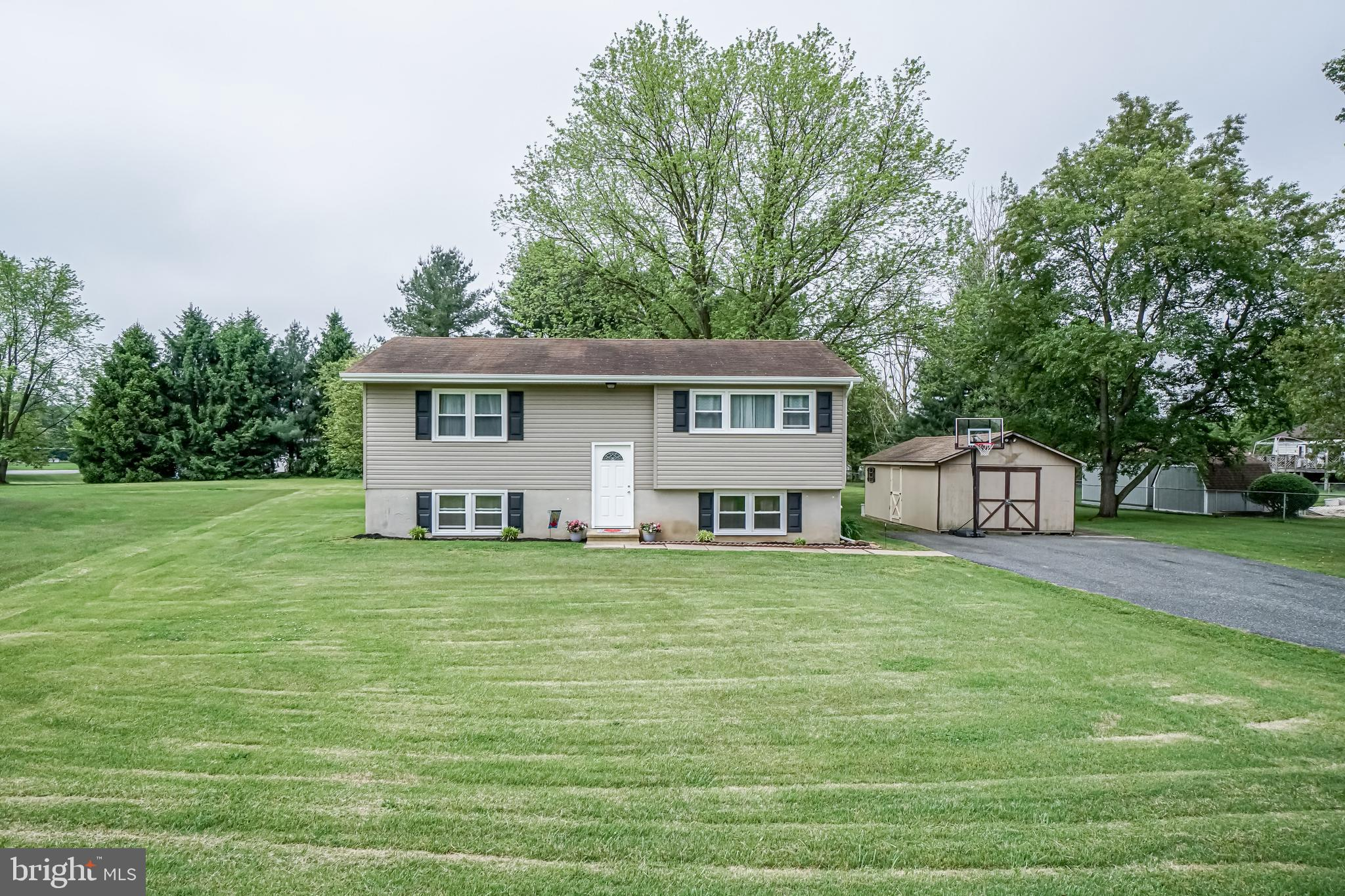 Lovely home located in a quiet cul-de-sac on an almost acre lot. The rear yard is perfect for entert