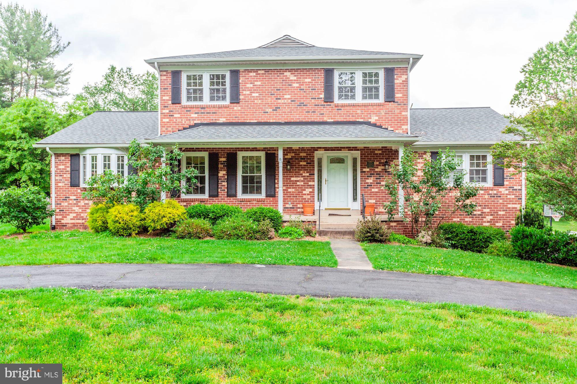 Serene setting welcomes you to this updated  4 sides brick colonial on .5 acre lot with front porch,