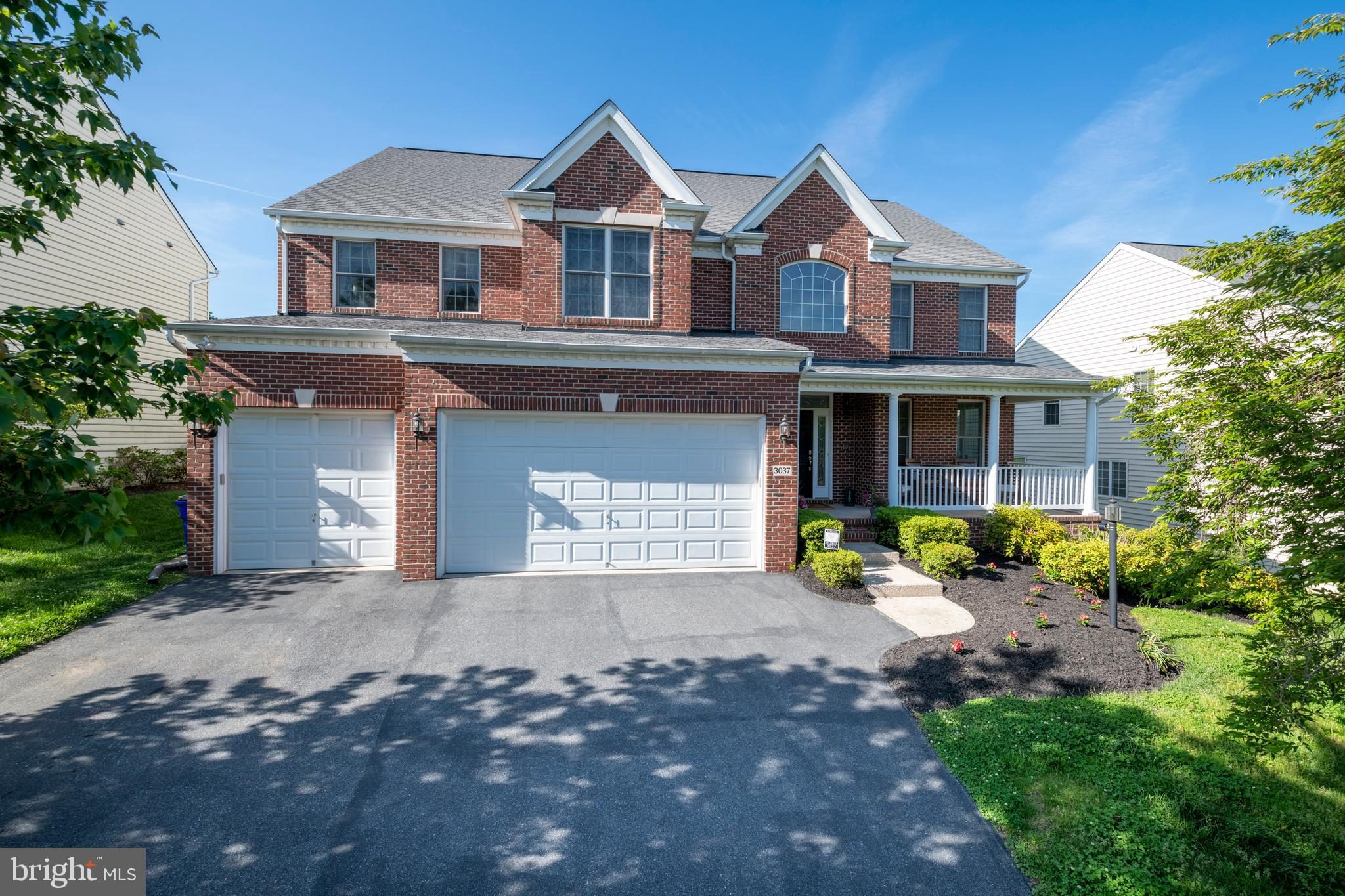This grand, brick-front, 6 bedroom, 6 full-bath, 3-car garage colonial on a quiet cul-de-sac opposit