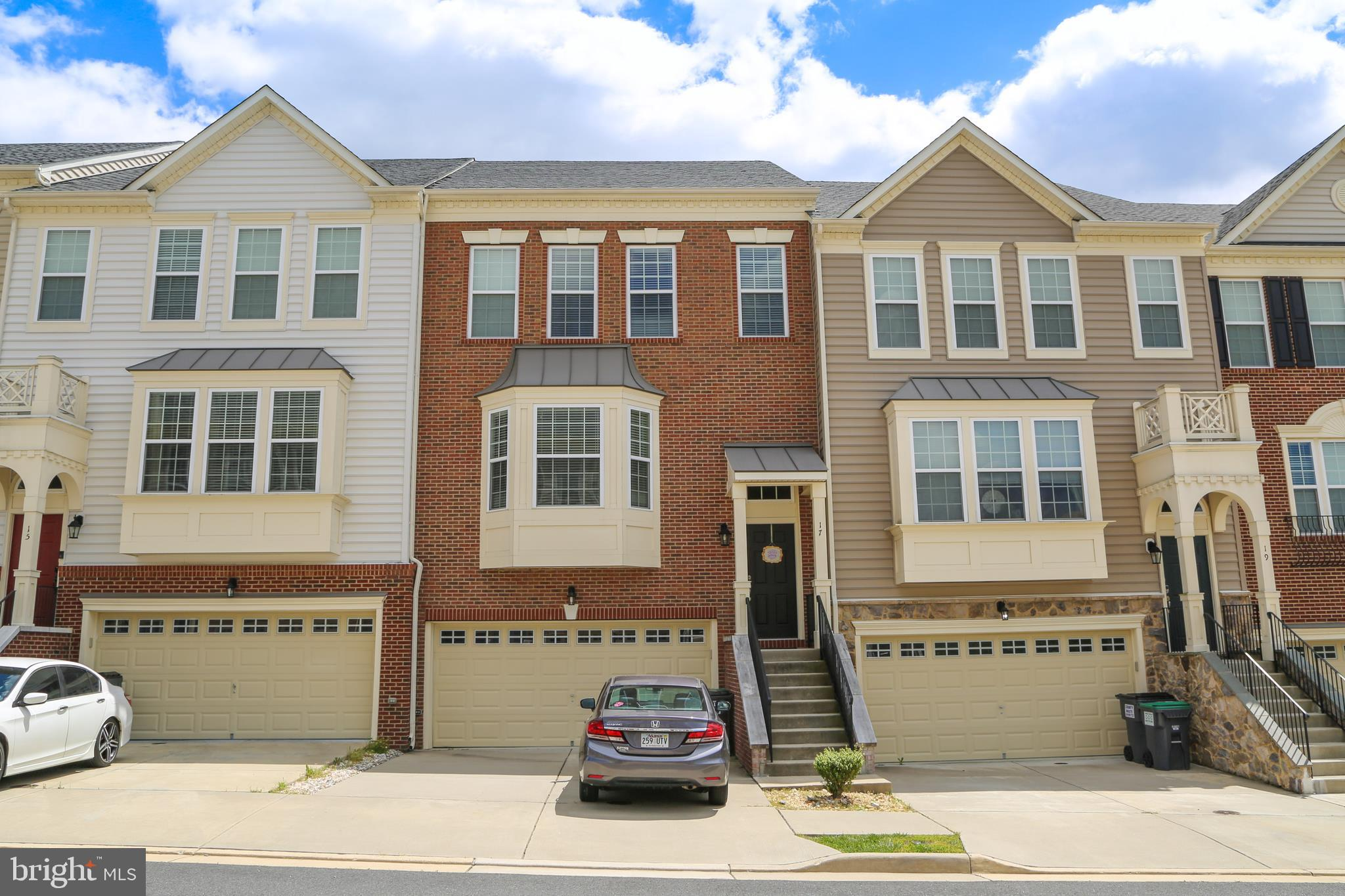 Custom Townhouse in COLONIAL FORGE. All three levels have bump outs which gives you over 2700 square