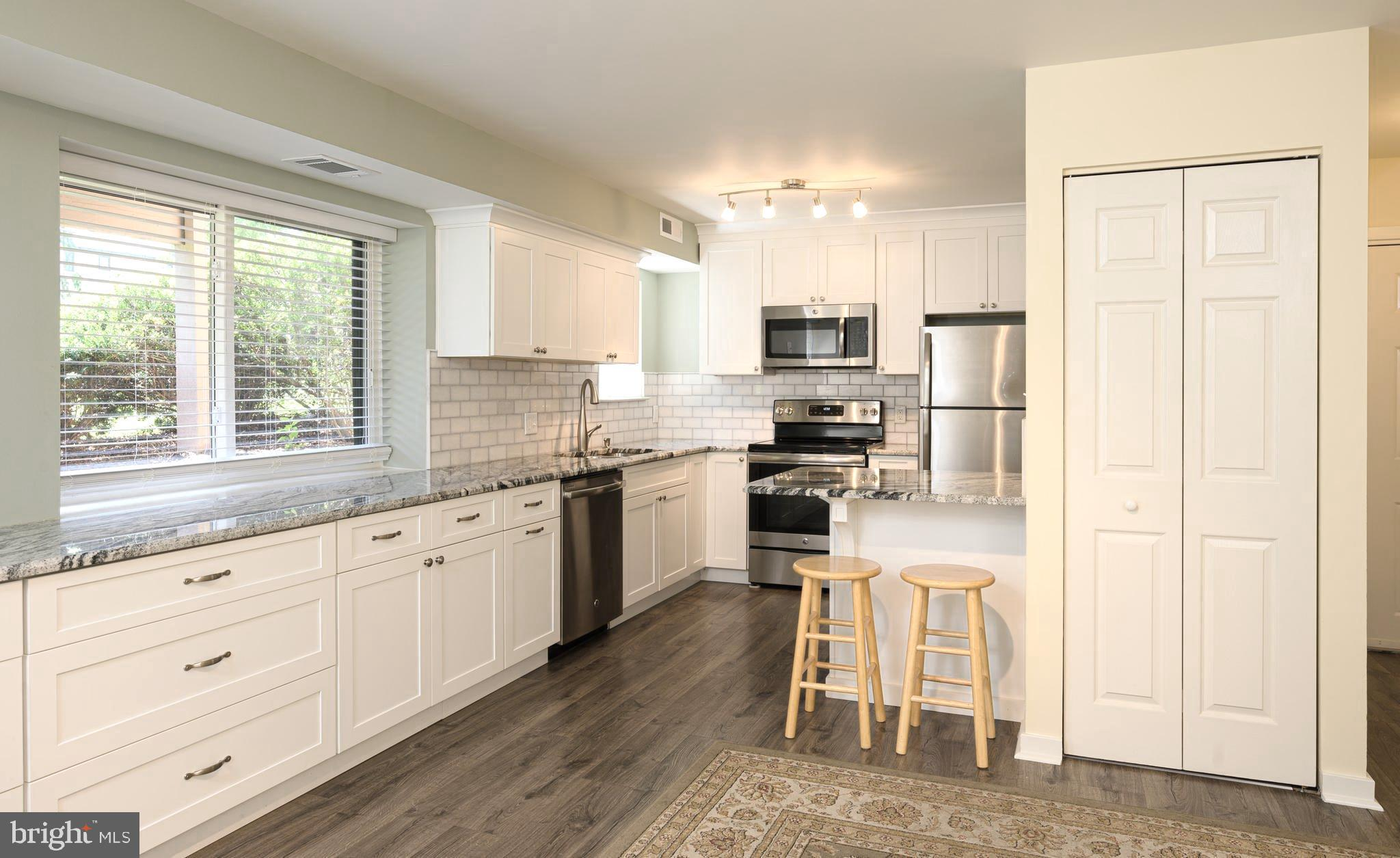 New, New, and Newer! Large windows allow this condo to be filled with bright, natural light! This 1