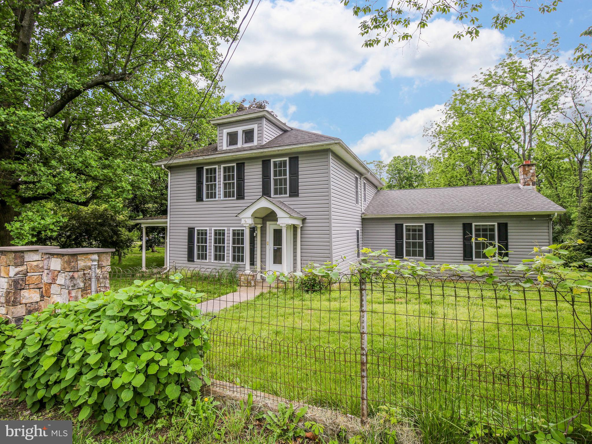 Your own private oasis awaits you with this beautifully restored and renovated classic beauty in a c
