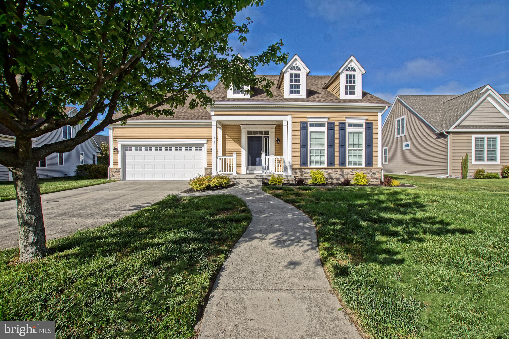 MOVE INTO TOWN! Lewes life is easy in this well-located 4 bedroom, 3 bath coastal inspired home with