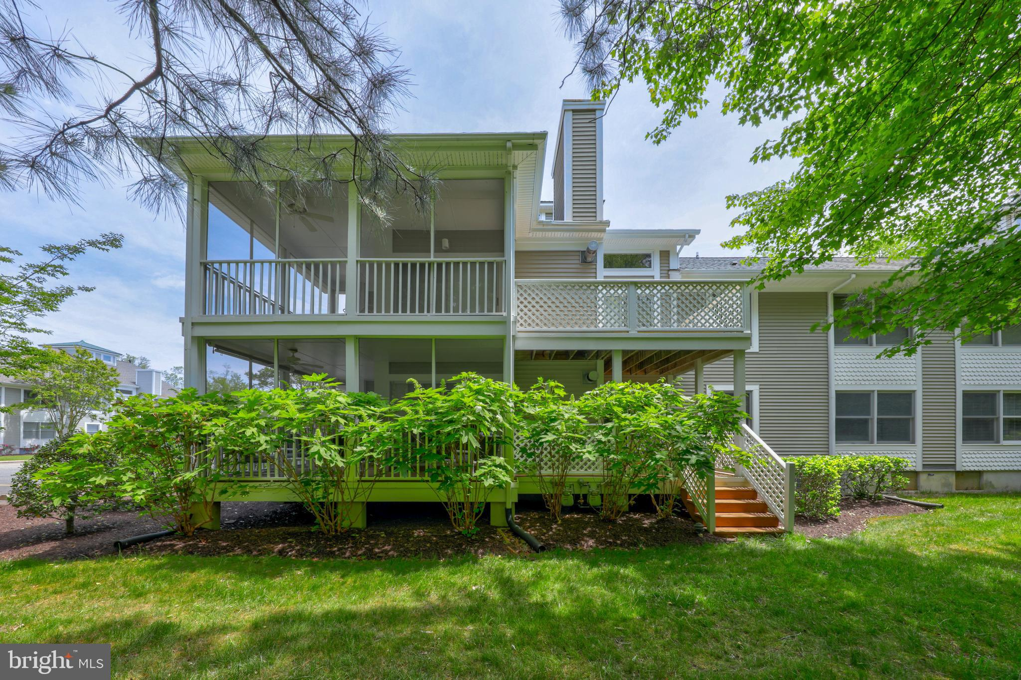 Unique and valuable location with landscaped backyard leading to privacy of Assawoman Canal ~ a favo