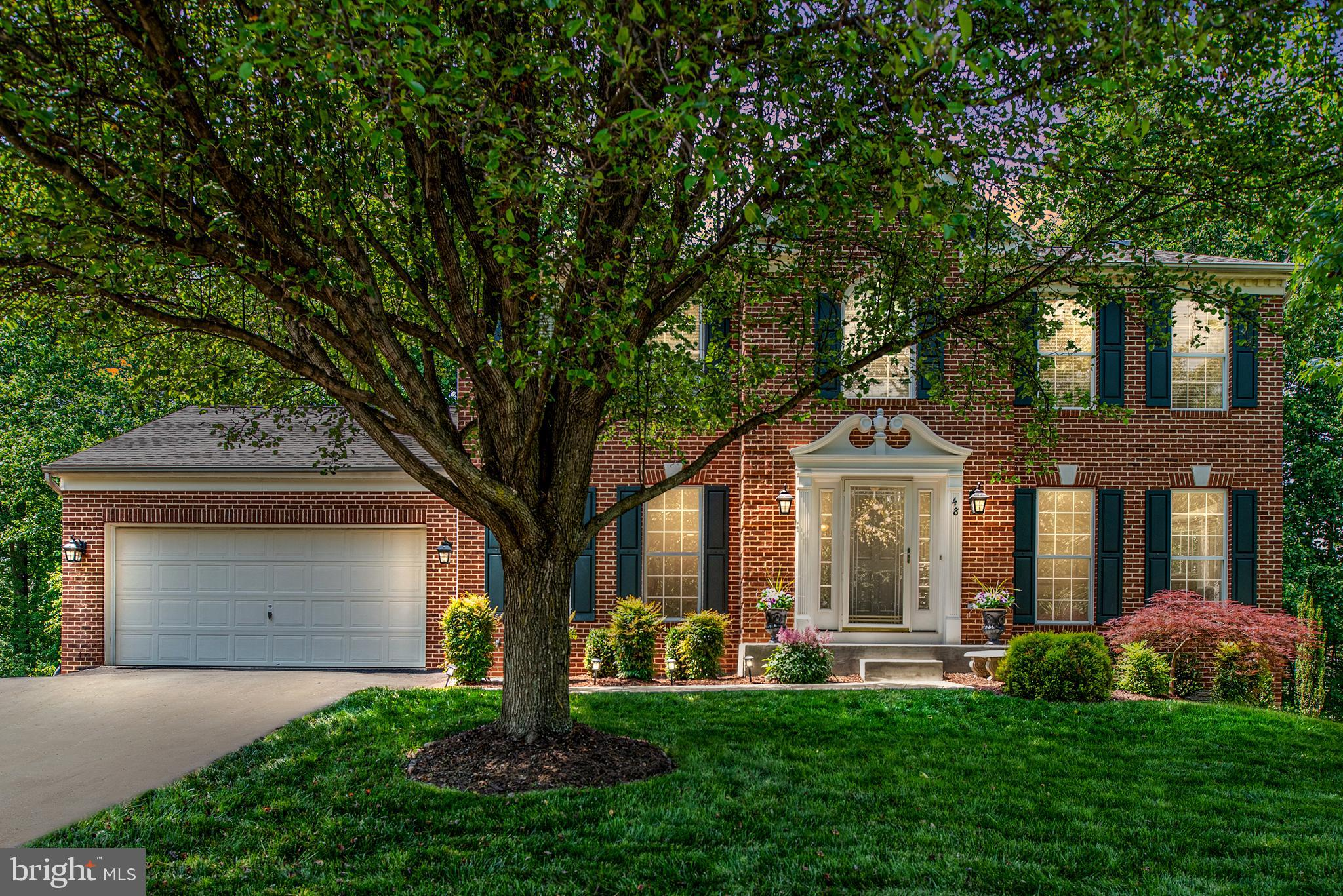 WELCOME HOME!!  This stunning brick front estate is ready for you!   This meticulously maintained ho