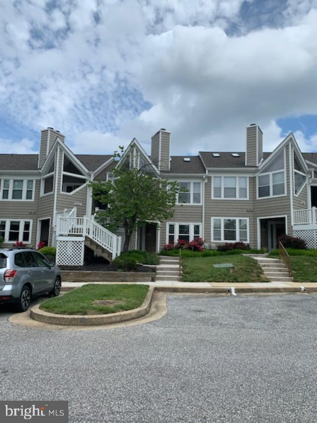 Bright and spacious open floor plan condo features spacious living room w/ wood burning fireplace. 2