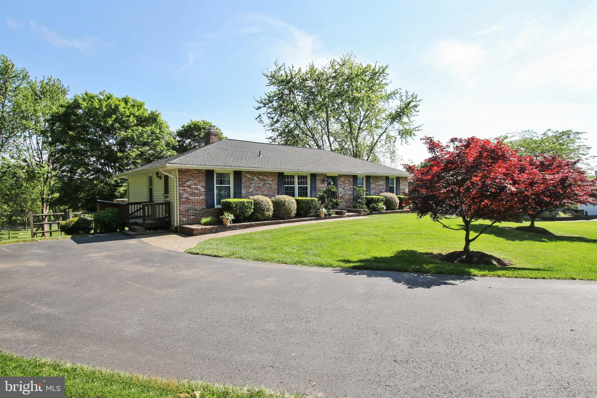 With too many updates to list this beautifully maintained home on nearly 1 acre of flat ground is mo
