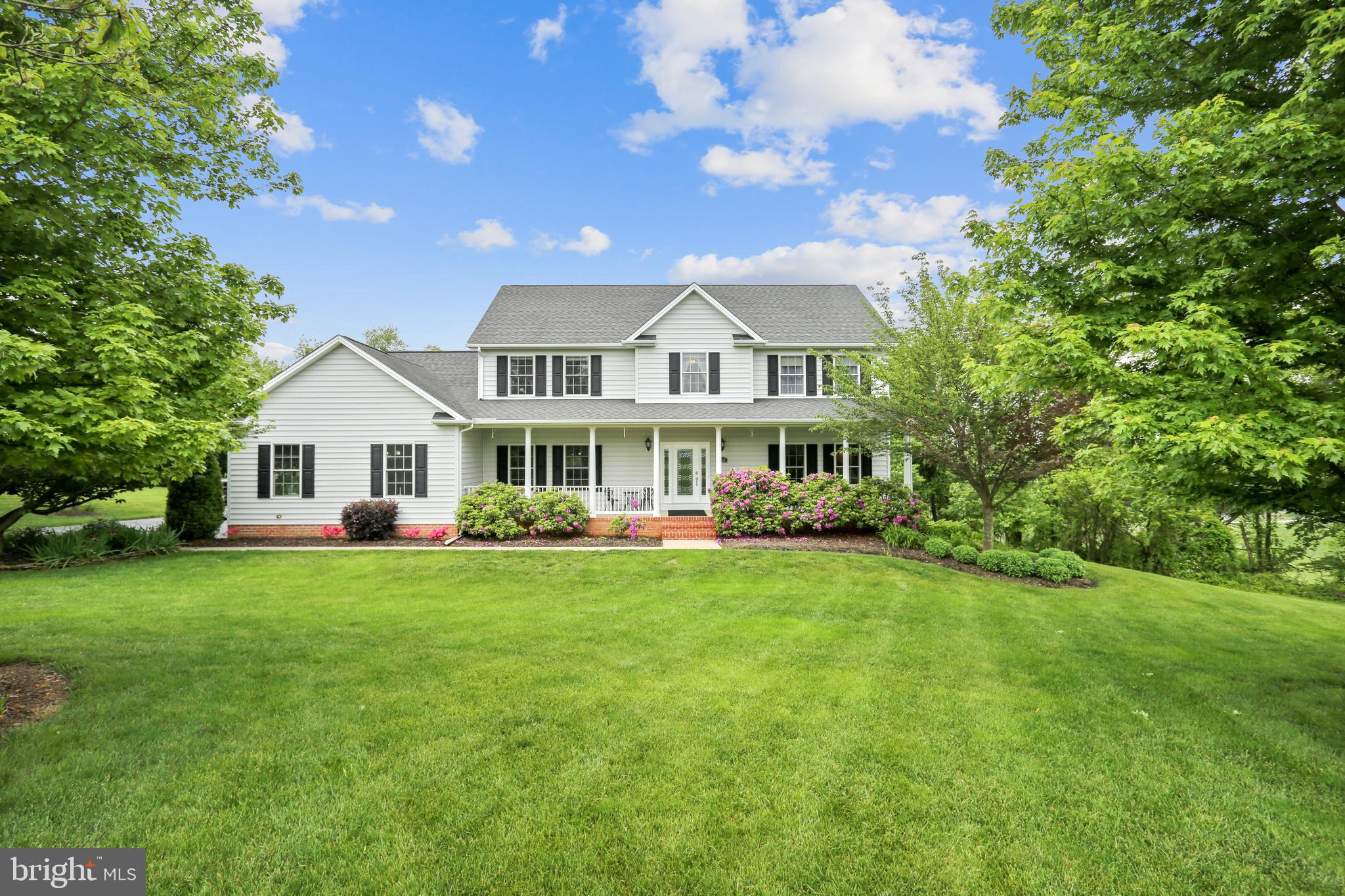A quiet retreat and park like setting on 2.79 acres awaits you in this meticulously maintained home