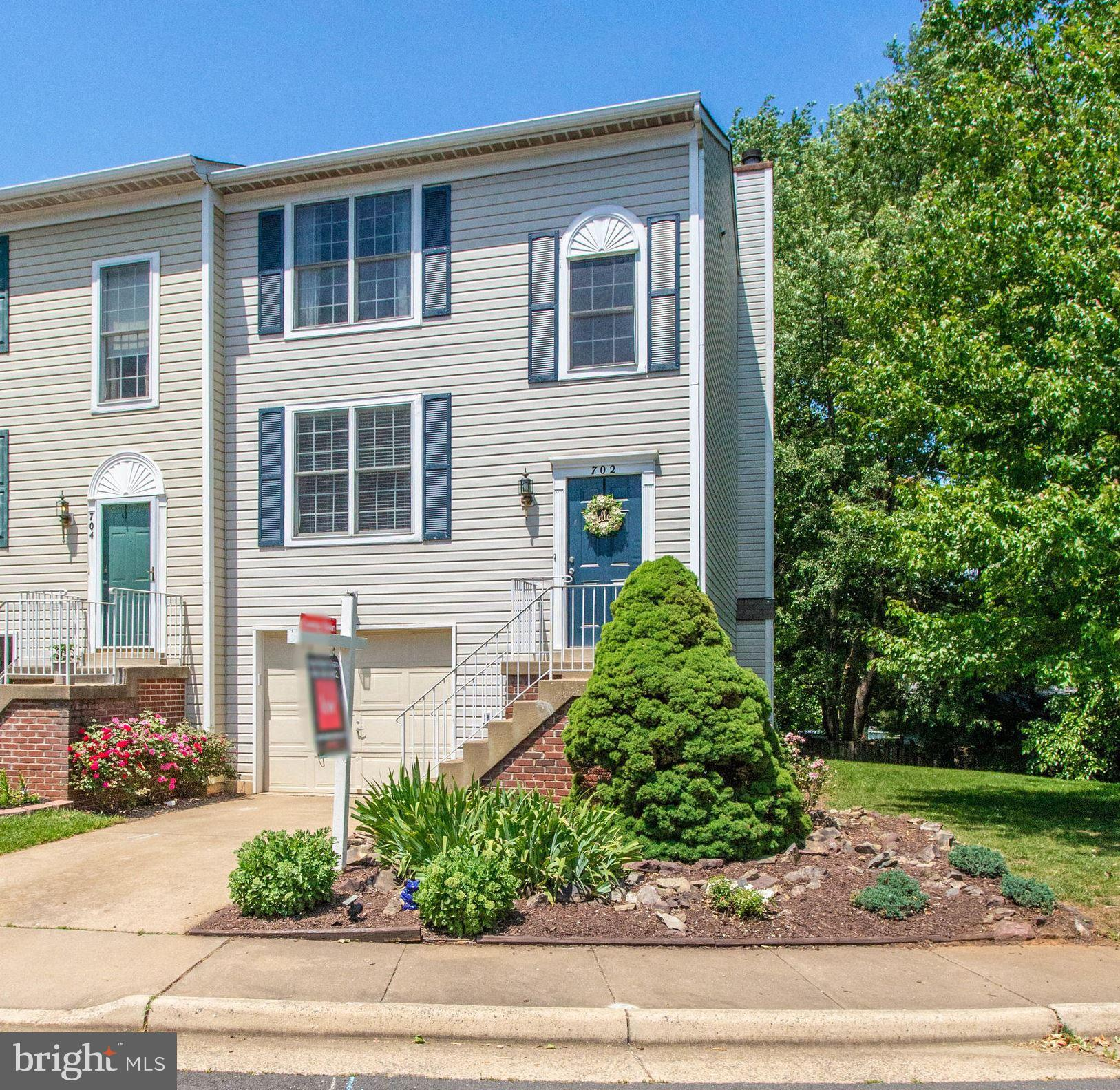 Light & Bright end unit with full walkout basement and fireplace.  Main Level hardwood floors. Fresh