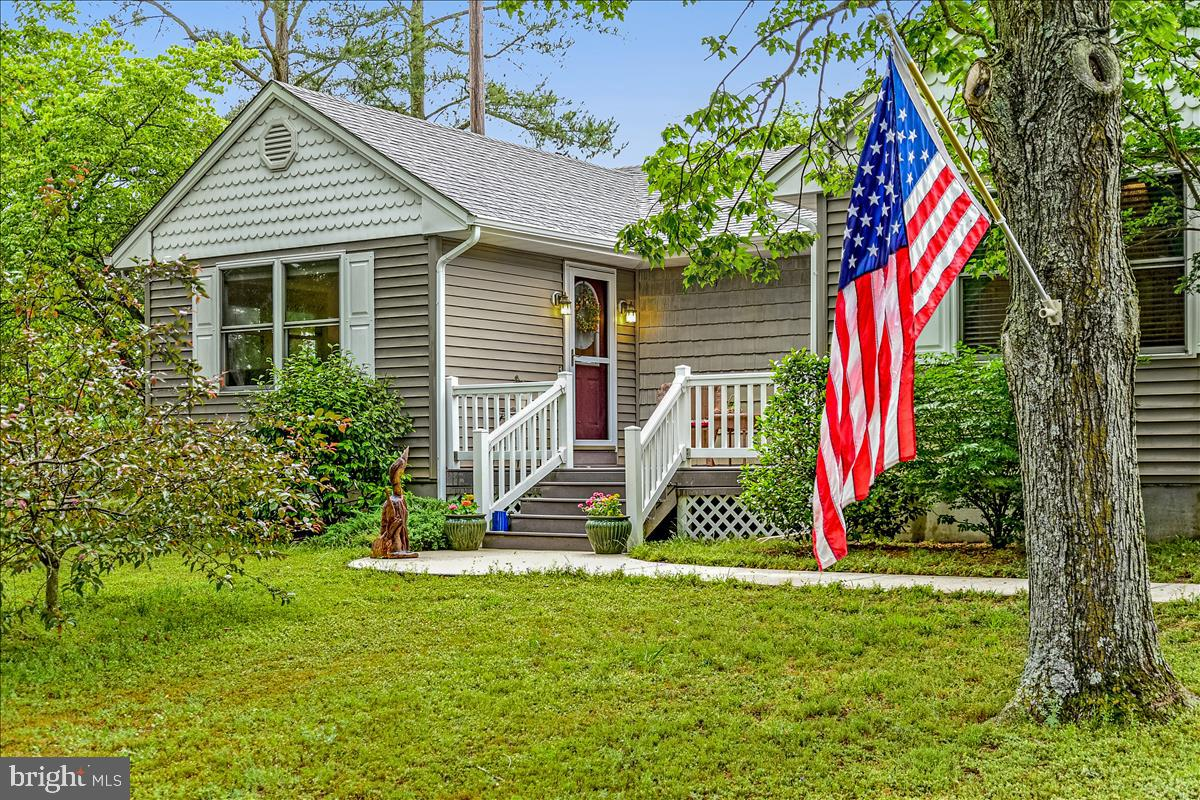 Don't miss this charming totally remodeled rancher in a small waterfront community. Enjoy the new 4
