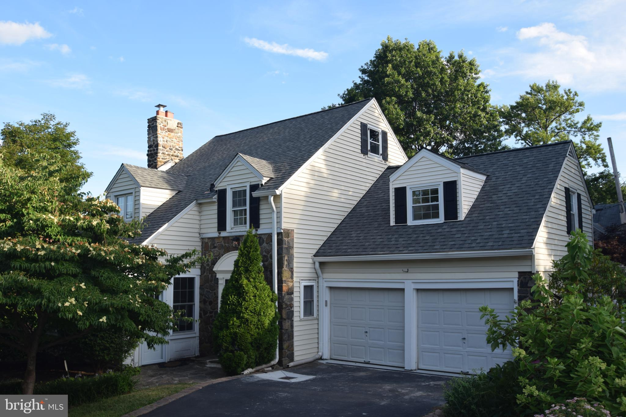 Immediate possession possible for this rarely available 4 bedroom, 2 1/2 bath stone Cape Cod style h