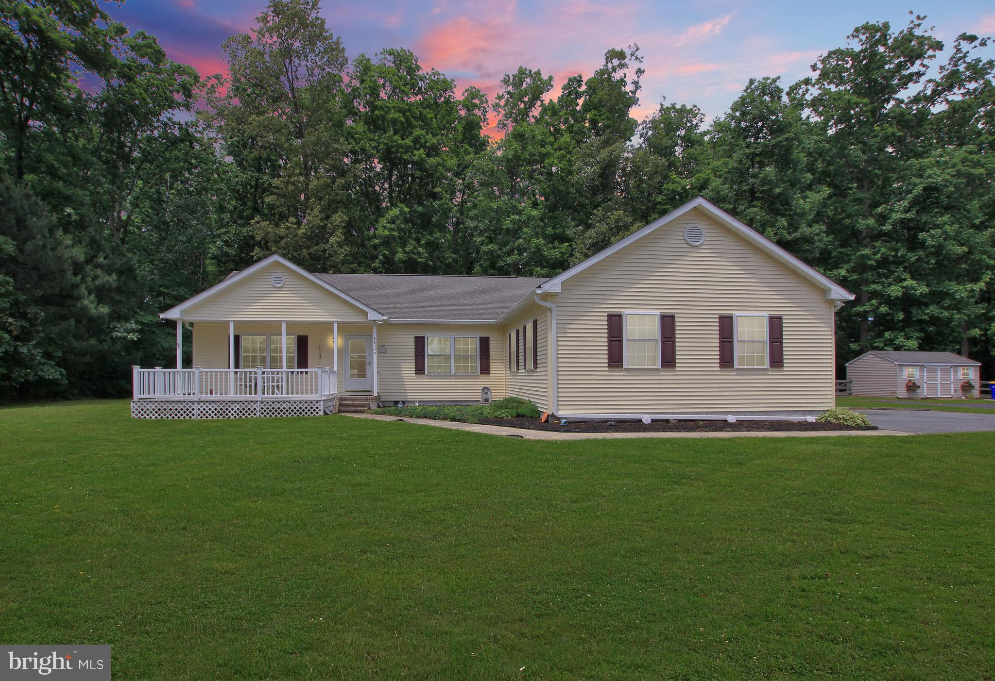 Rancher style home located on a beautiful 3/4 acre wooded lot in sought out Milton area. The home fe