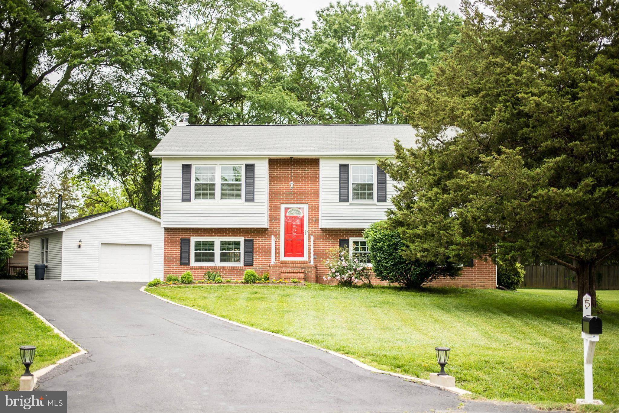 Beautiful, updated split level in an absolutely wonderful location: being situated at the end of a c
