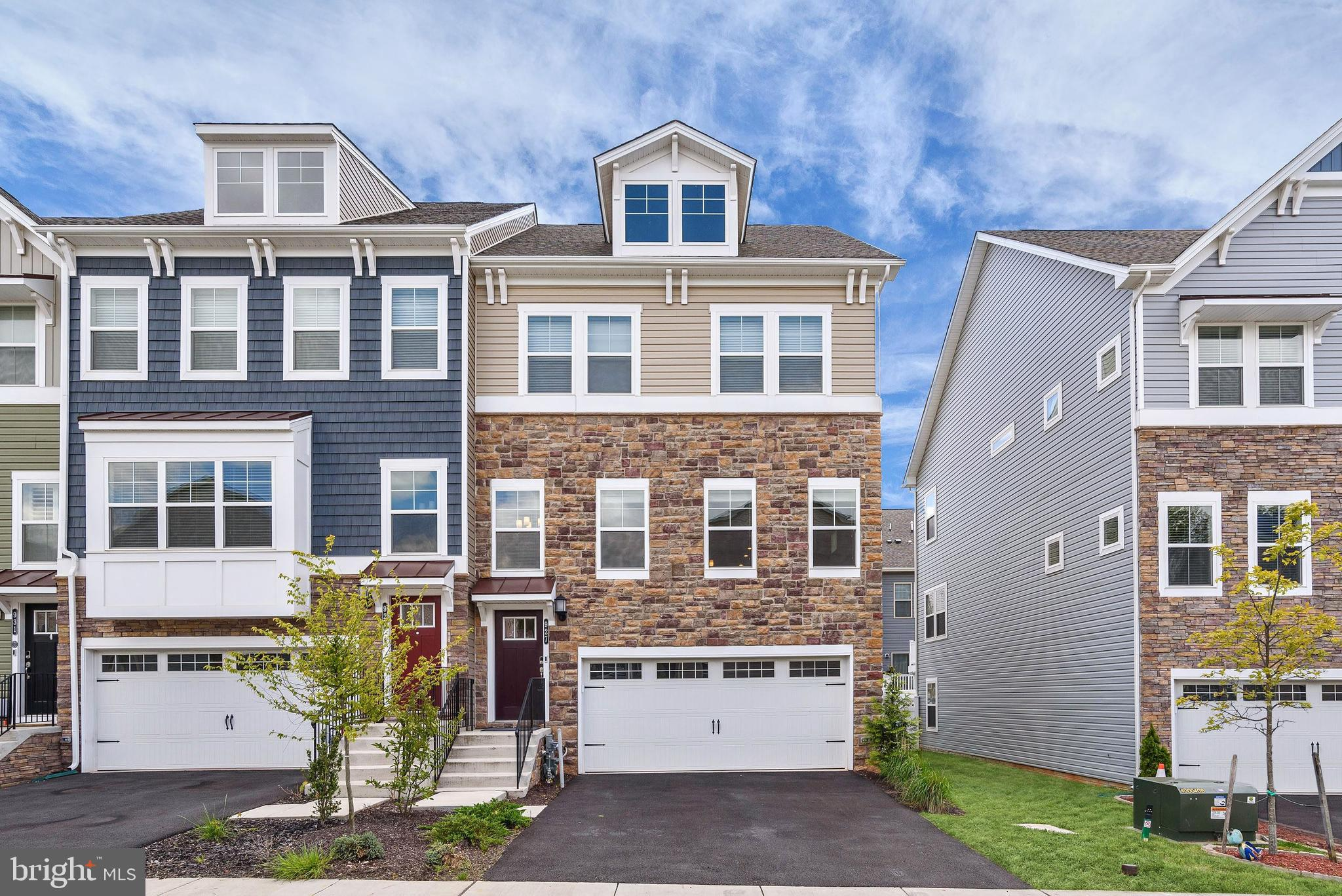 Gorgeous!  Like New!  This absolutely beautiful end-unit town home is the largest model with 3000+sq