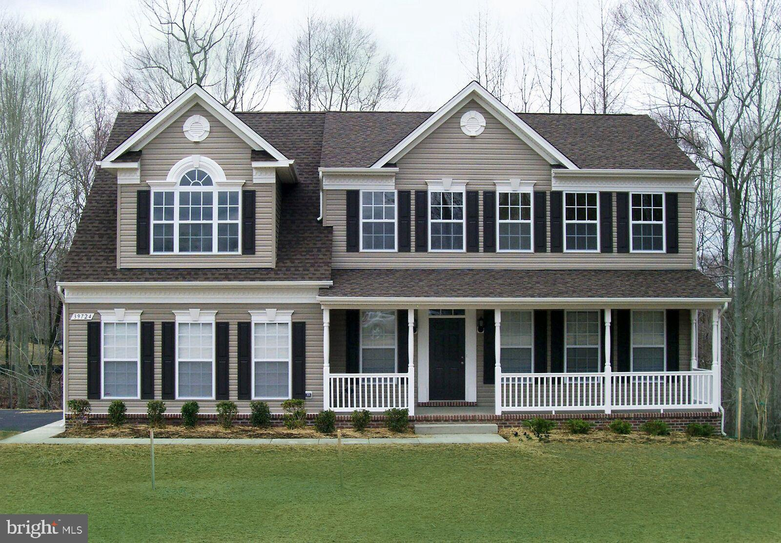 New Construction on lot 11 in Foxwood- This Grandhaven floor plan has upgraded hardwood through out
