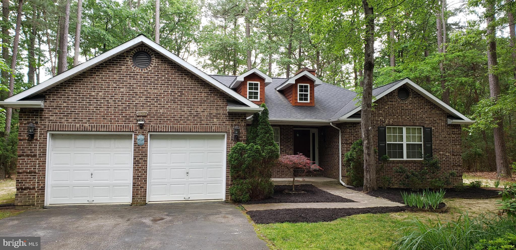 CHECK OUT THIS ROOMY RANCH! Five-bedroom updated Ranch/Rambler. Nestled in a pretty wooded setting,