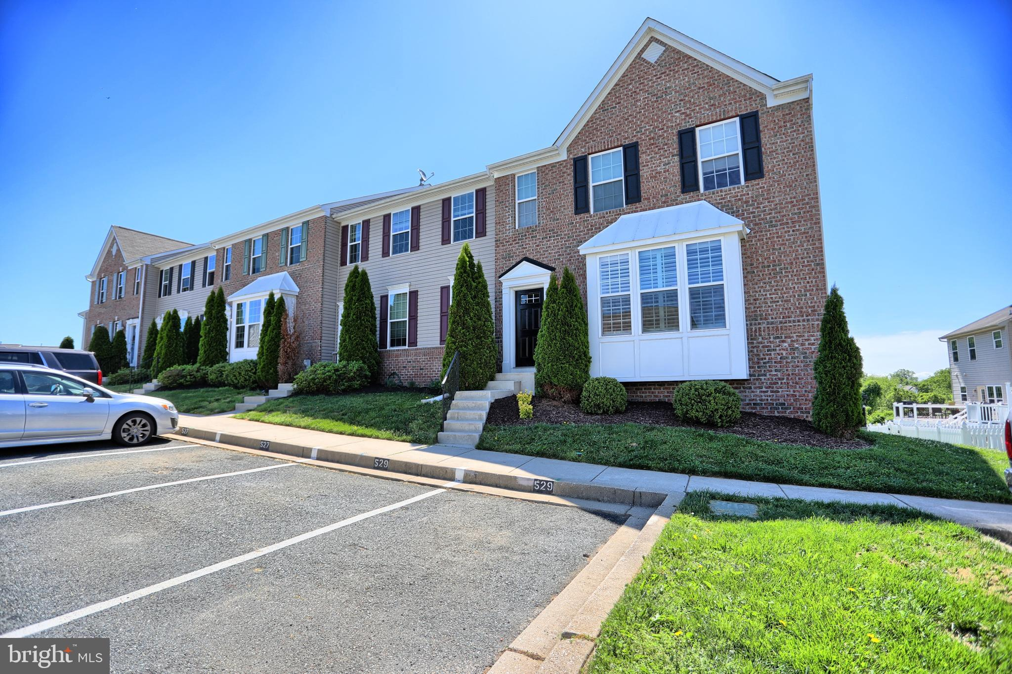 Beautiful brick front END OF GROUP TOWNHOME in desired Monmouth Meadows Community. Home offers 3 bed