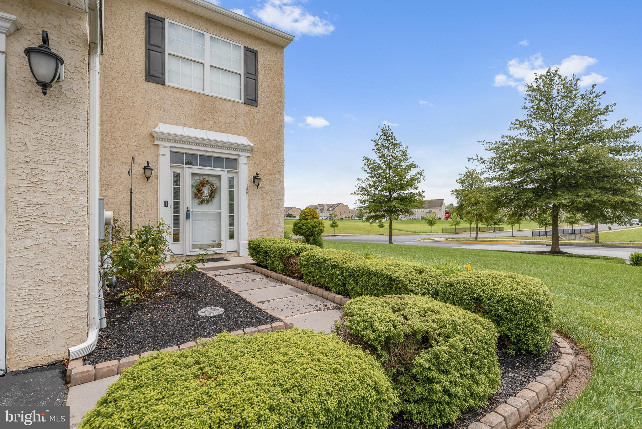 End Unit Townhouse situated on a beautiful corner lot with such curb appeal and beautifully cared fo