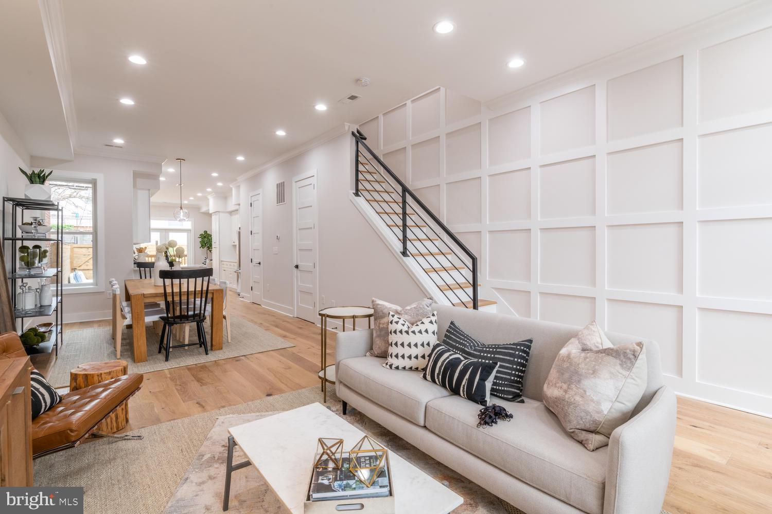 Stunning renovation in Eckington!! This expansive open layout is flooded with natural light and luxu