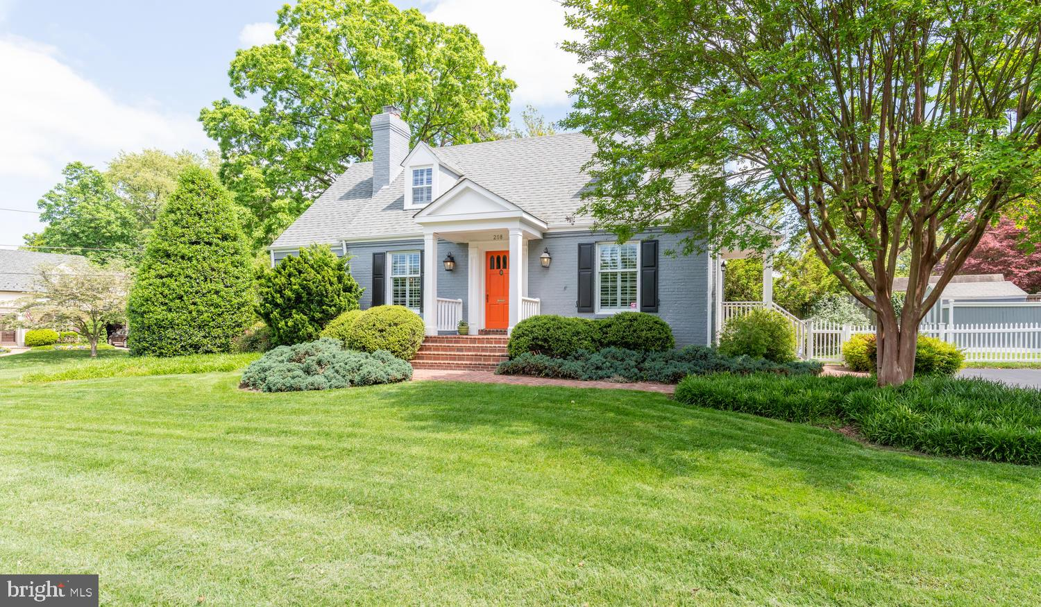 Stately and meticulously maintained and updated Cape Cod on premium corner lot in leafy Woodmoor. Th