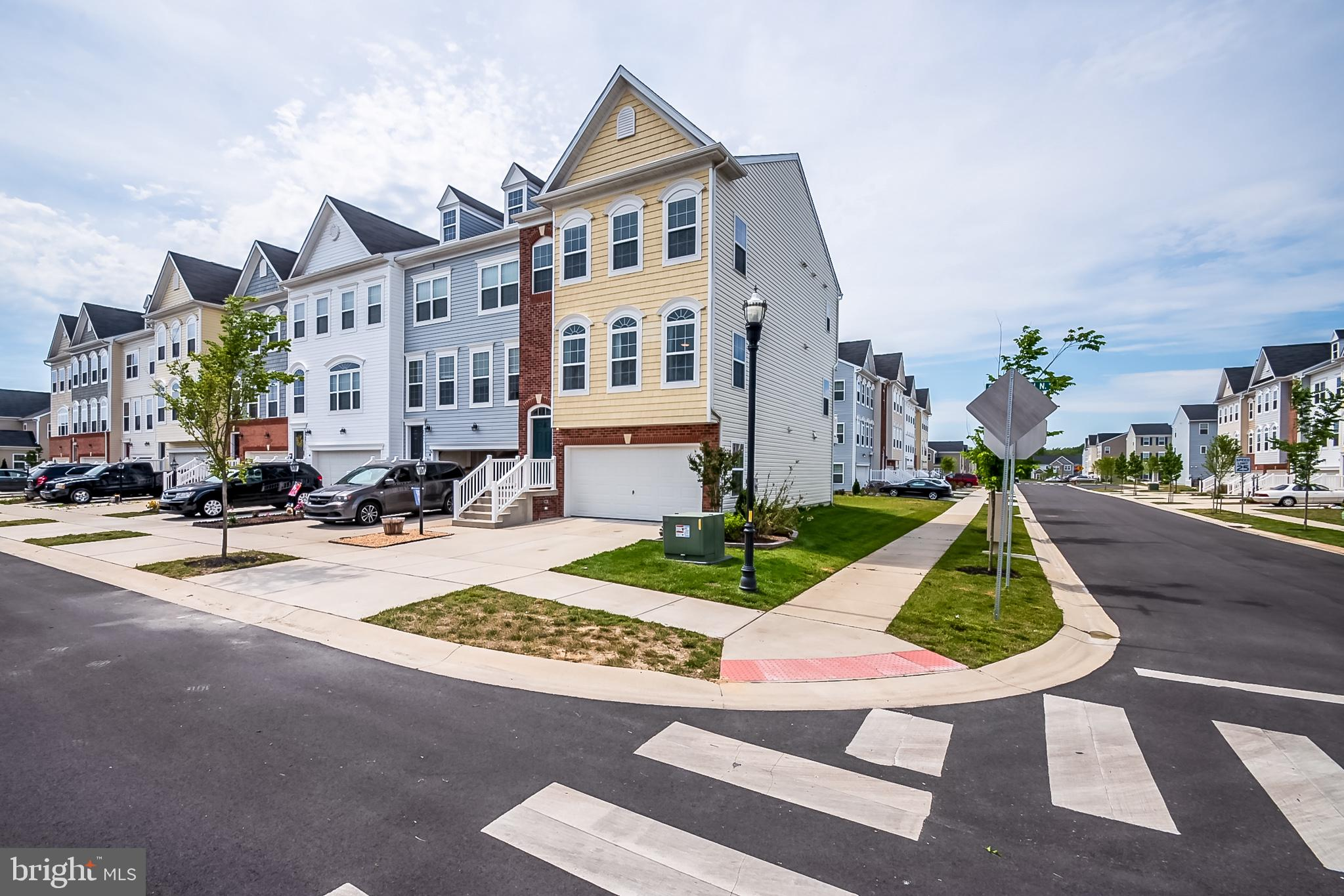 An absolutely gorgeous and sophisticated end unit townhome awaits new owner(s)! This beautiful and w