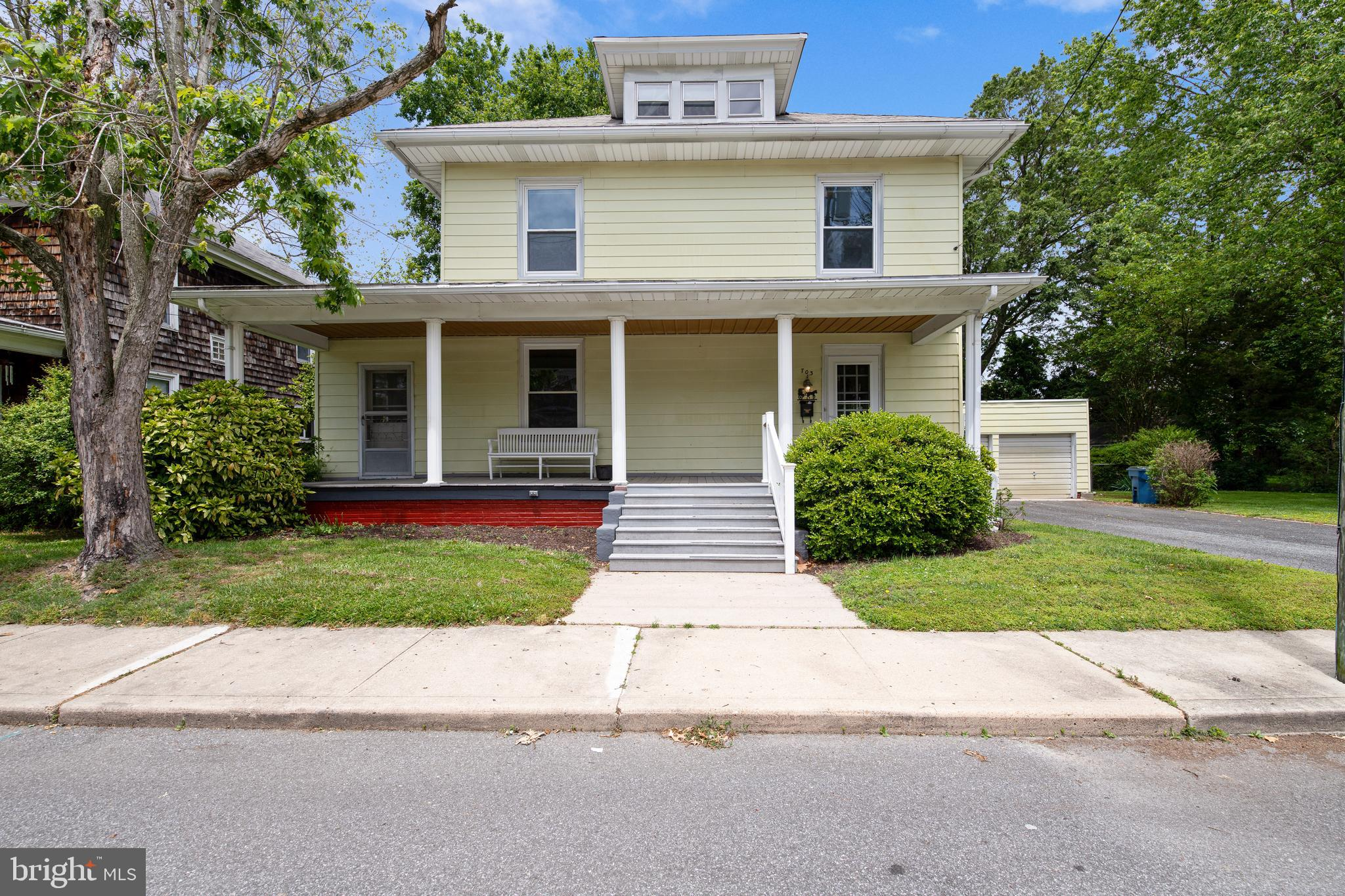 This classic American Foursquare home sits on a gorgeous double lot just a block away from Delmar Mi