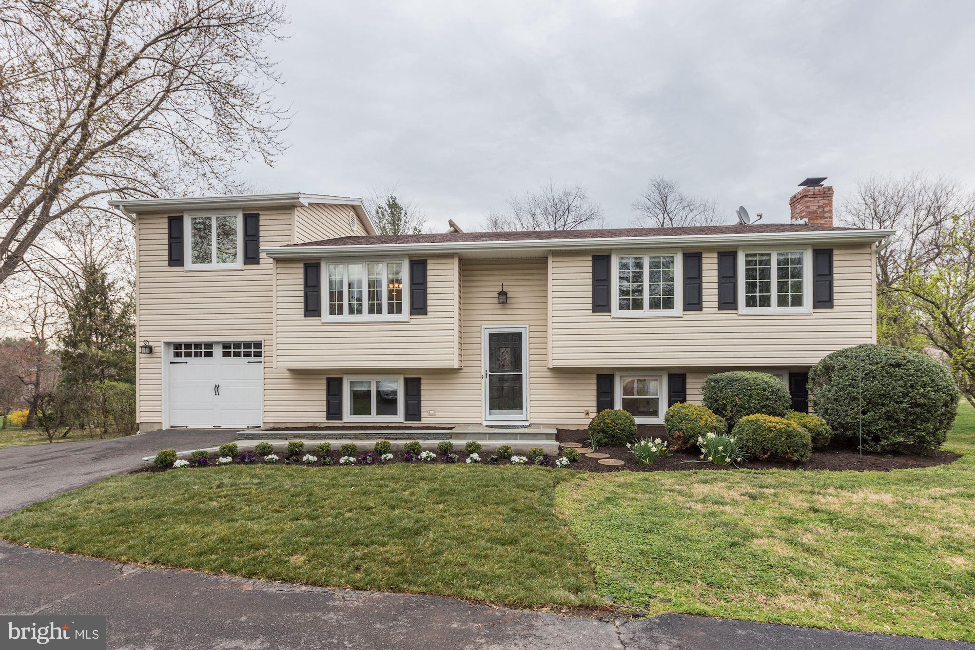 This updated split-foyer house is nestled at the end of a cul-de-sac on a private drive.  Located in the Falls Manor community of sought-after Lexington Estates and award-winning Langley High School Pyramid.  The .66 acre yard with its chestnut, fig, apple and cherry trees (makes for great pies!) feels more like a large, two-acre property given the wide-open common space adjacent to the property (yet without paying the additional taxes!). Inside, the inviting kitchen opens up to a sitting room with built-in shelves/bookcases and flows out to the deck with a bucolic view of the expansive yard. The main level also includes three bedrooms and two full baths, and a bonus/flex room which can be used as an office, sitting room or bedroom. The lower level features a large family room with wood-burning fireplace and walk-out access to the backyard patio, a full bathroom, bedroom or office, and a mudroom located directly off of the garage. Much more to see and the location is hard to beat - secluded, yet only minutes from Great Falls Village.