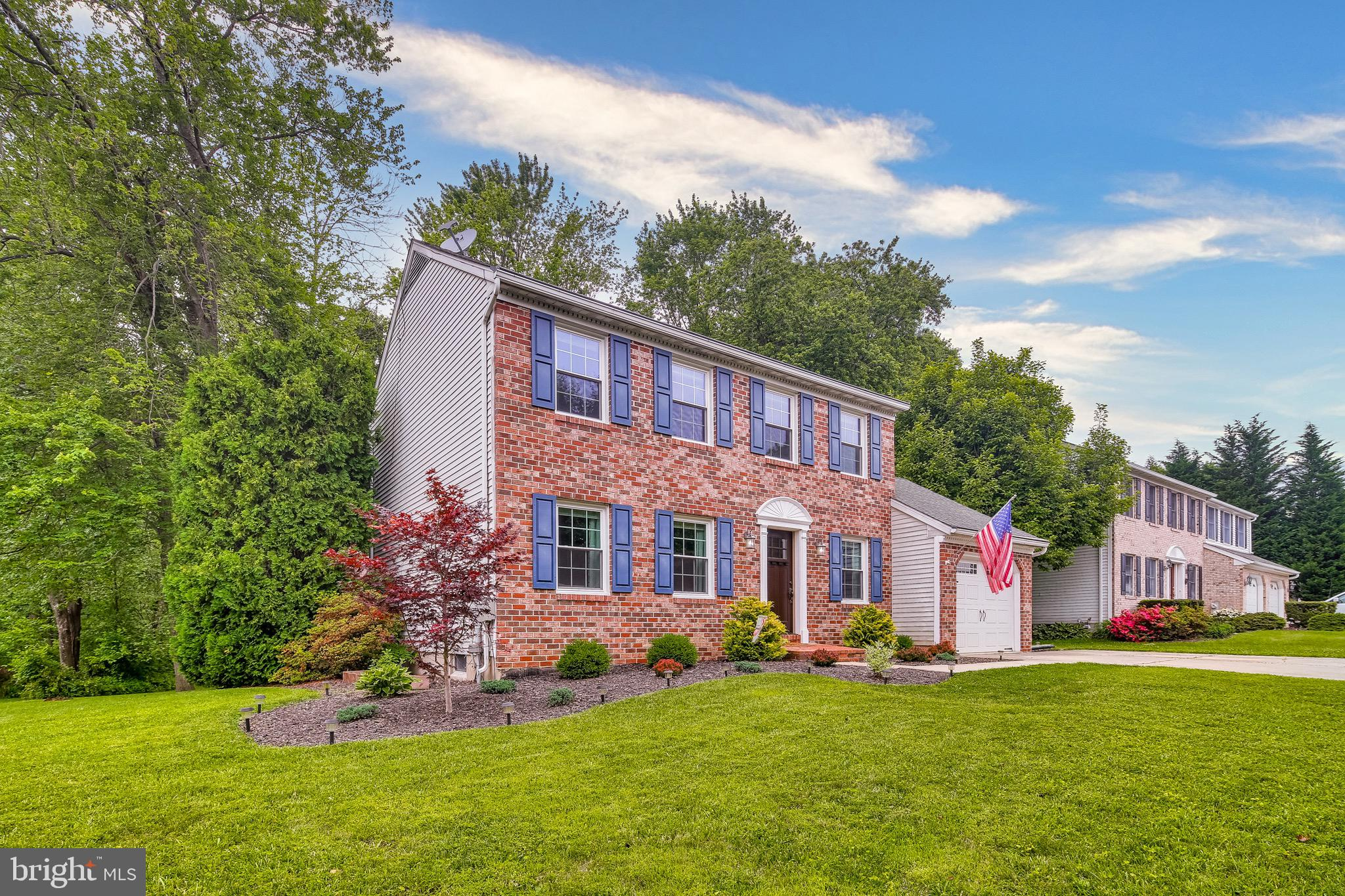 Welcome to this Stunning Brick Front Colonial! This home features a wrap around deck that overlooks