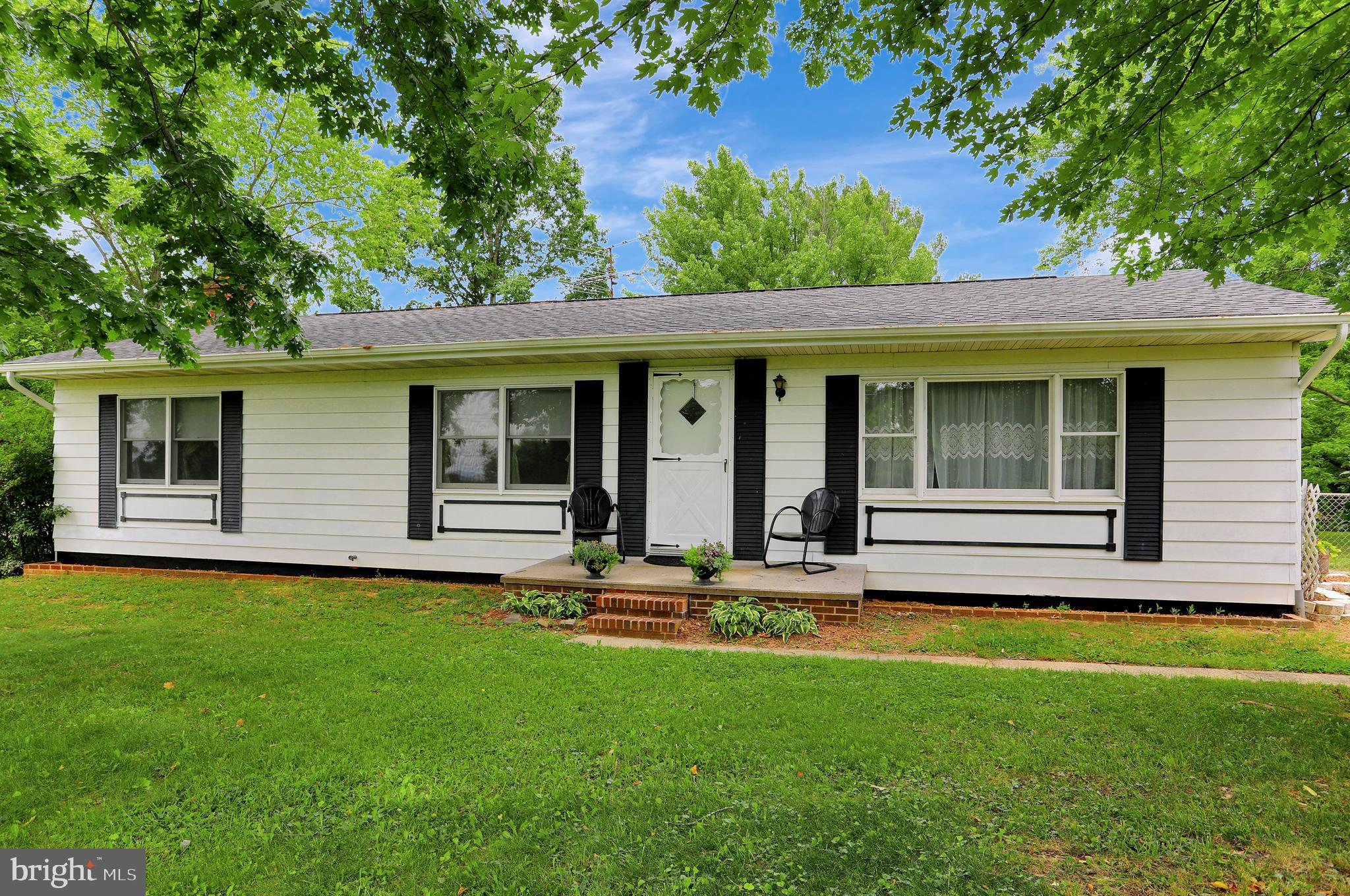 3 Bedroom 1.5 Bath Ranch Home offering 1500 Sq Ft of living space with a 2 car detached over-sized g