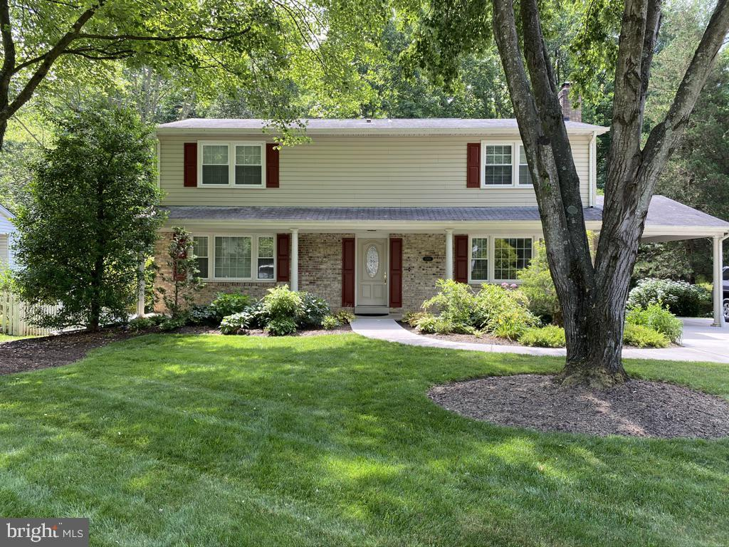 Located in one of the most popular communities in Northern Virginia, 7209 Reservation Dr is  a beautifully maintained home with more than 2600 square feet of living space on three levels. Pull up under the carport and come in through the side door for a drama-free way to bring your things in on weather days. You'll love the fireplace in the family room and the easy access to the generous deck with gorgeous views of the woods and stream behind the house. It's the perfect entertaining deck or your quiet spot to meditate with nature.  The main level offers a family room with fireplace, a formal living room, dining room and kitchen, plus a powder room and access to the finished lower level. The roomy master on the upper level includes a private ensuite. The remaining three junior bedrooms, also on the upper level, are generously sized and share a hallway bathroom. The lower level boasts a spacious finished media room--perfect for games, work out, home office. Close to the Fairfax County Parkway, Burke Lake, South Run, shopping. Easy access to DC, many military installations. ADDITIONAL PHOTOS on 6/18