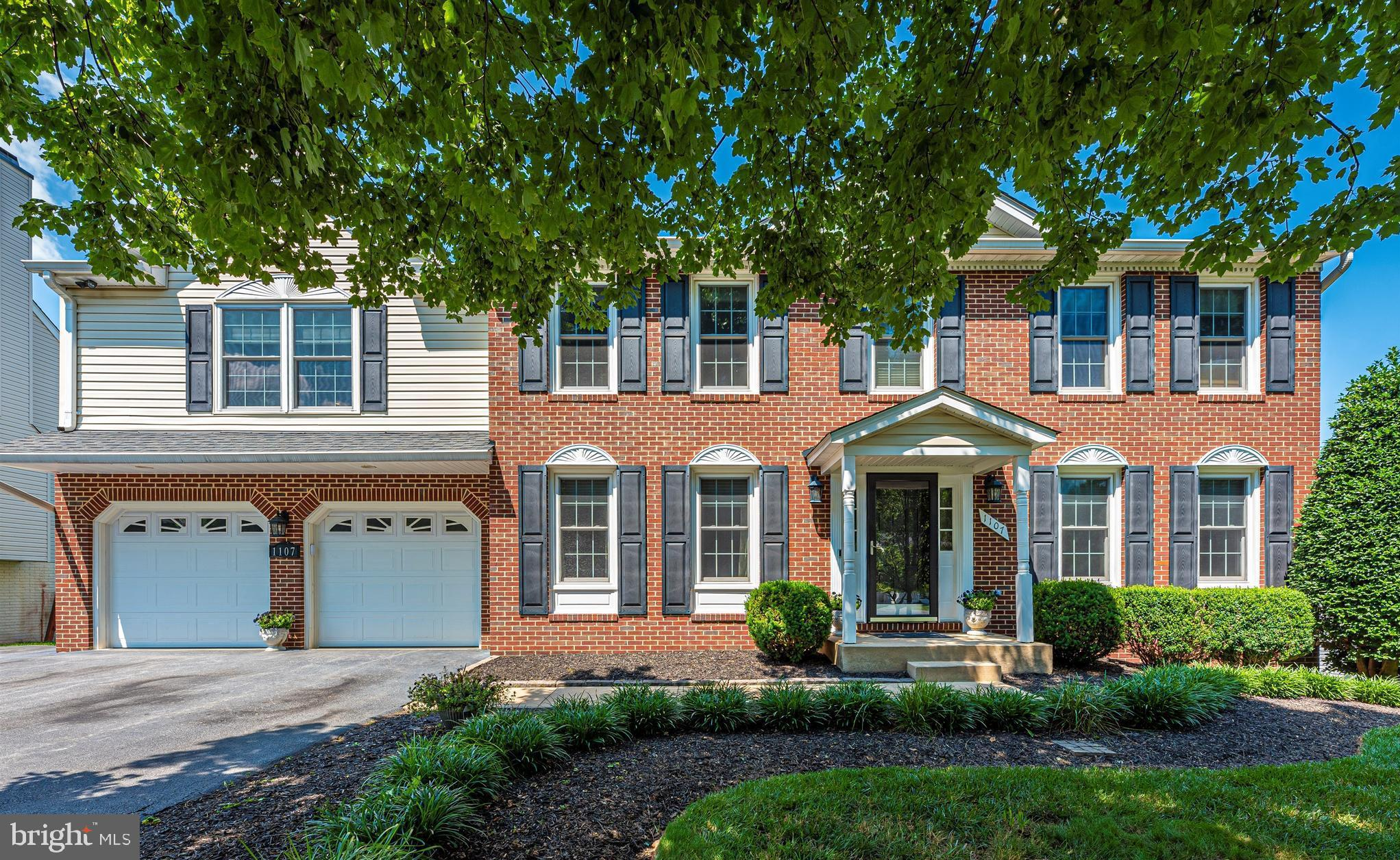 Stately brick front colonial in Village Gate on quiet cul de sac with massive master suite addition.