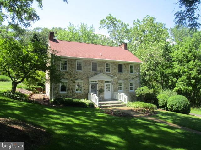 Restored stone colonial home with expansive family room addition which was tastefully done and maint