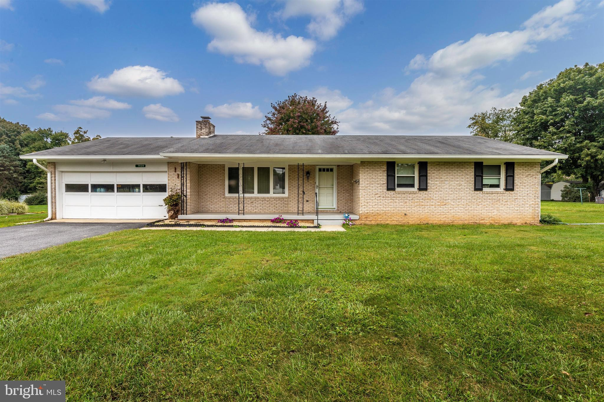 Great brick rancher - just outside the city limits!   3 bedrooms & 2 full baths;  Large front porch