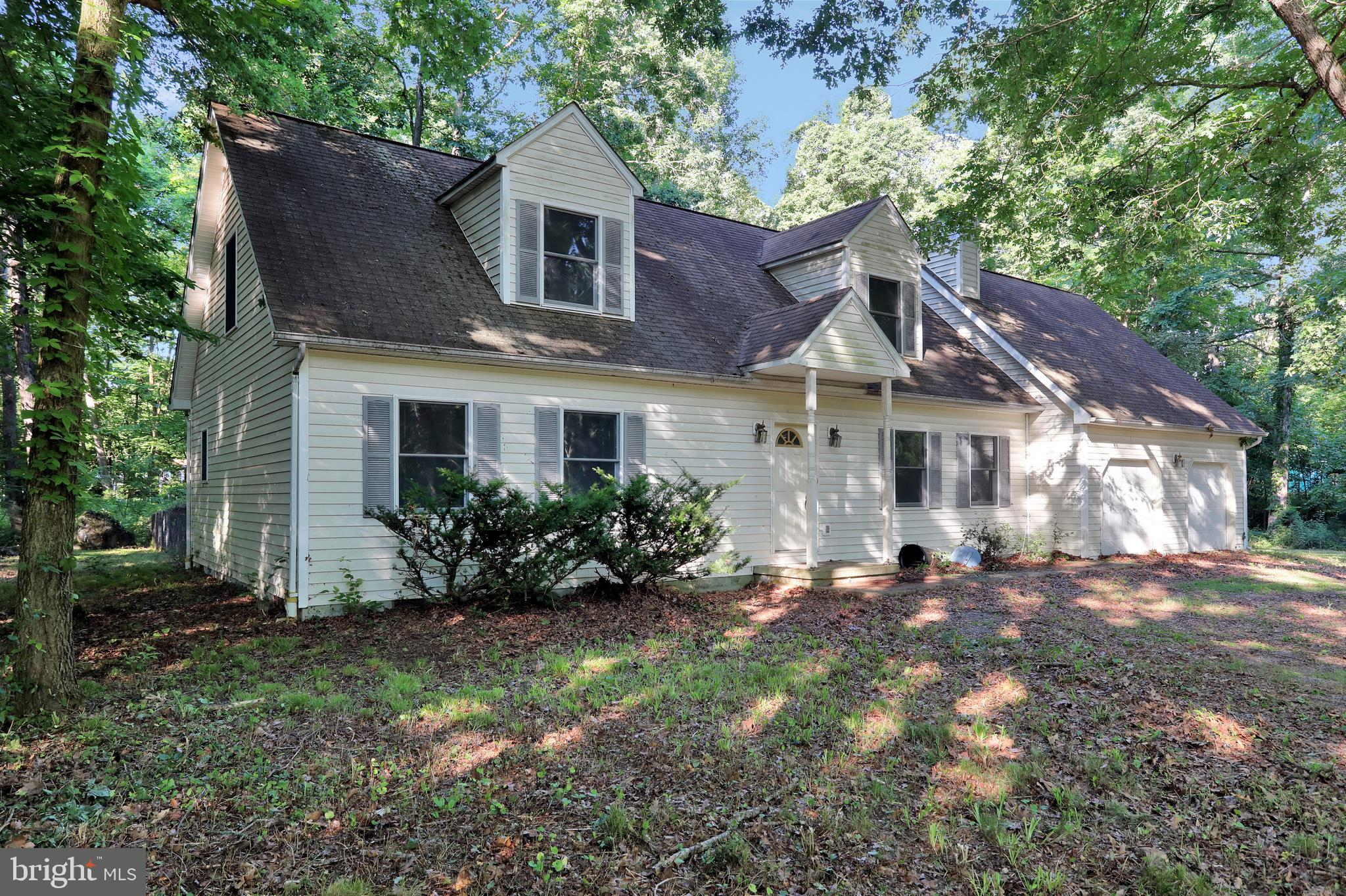 Fixer Upper in Shepherd West.  Quaint 3 BR, 2.5 BA Cape Cod sitting on over 2 acres! Home includes a